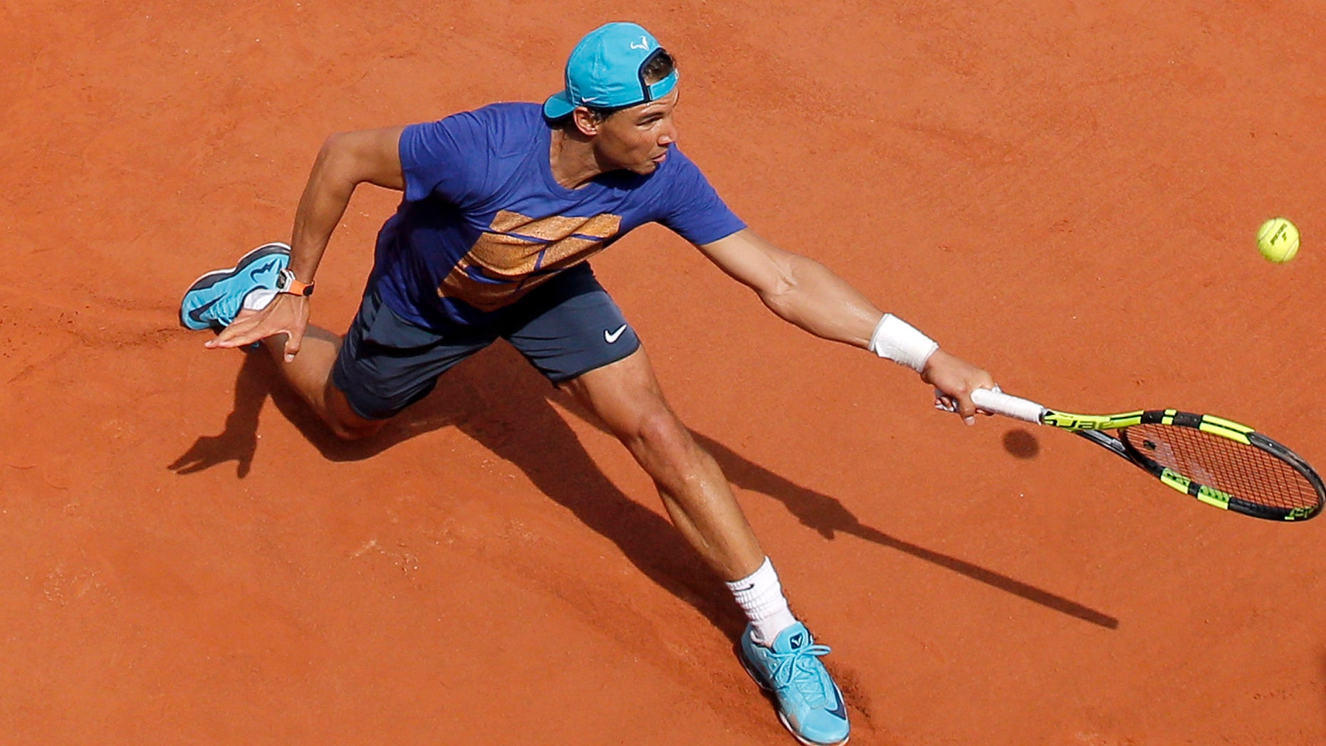 Spain's Rafael Nadal returns the ball during a training session of the French Open tennis tournament at the Roland Garros stadium, in Paris, Saturday, May 21, 2016 . The French Open starts Sunday May 22. (AP Photo/Christophe Ena)