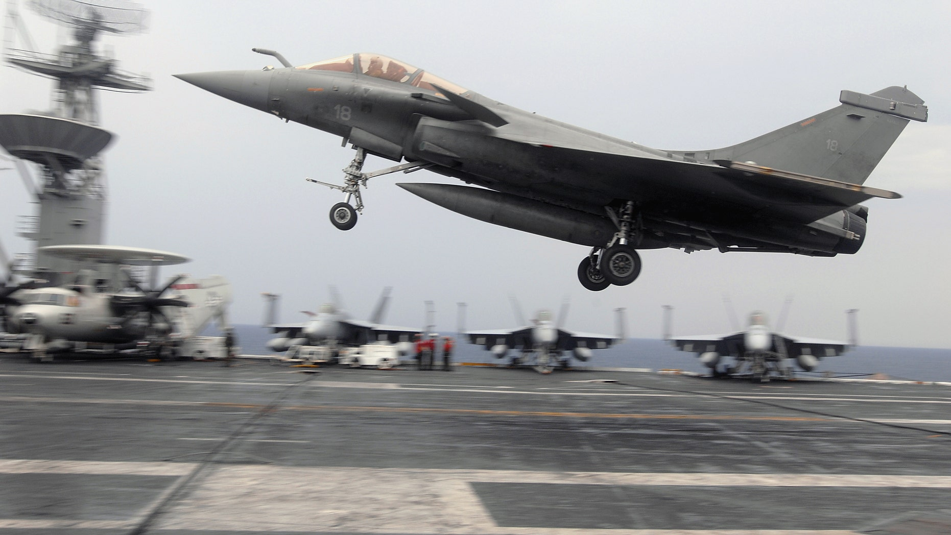 """File photo - A French F-2 Rafale fighter performs a touch-and-go during combined French and American carrier qualifications aboard the aircraft carrier USS Theodore Roosevelt (CVN 71). The Theodore Roosevelt Carrier Strike Group is participating in Joint Task Force Exercise """"Operation Brimstone"""" off the Atlantic coast. (U.S. Navy photo by Mass Communication Specialist 3rd Class Sheldon Rowley/Released)"""