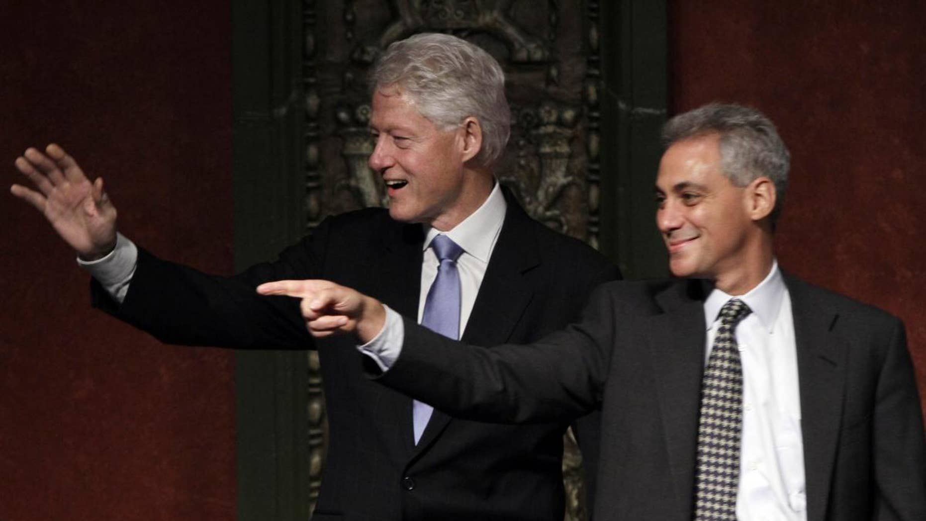 Former President Bill Clinton, left, appears at a rally for Chicago mayoral candidate and former White House chief of staff Rahm Emanuel, Tuesday, Jan. 18, 2011, in Chicago. Emanuel is vying to succeed the retiring Mayor Richard Daley. The election is Feb. 22. (AP Photo/M. Spencer Green)