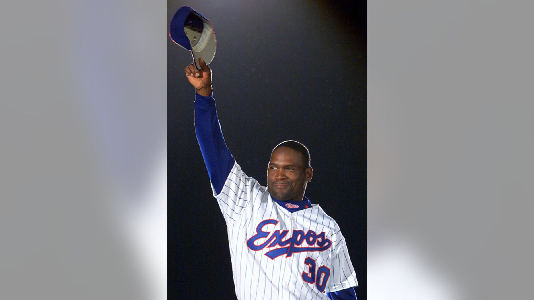 April 6, 2001: Tim Raines acknowledges applause from fans as he is presented before the Montreal Expos' home opener.