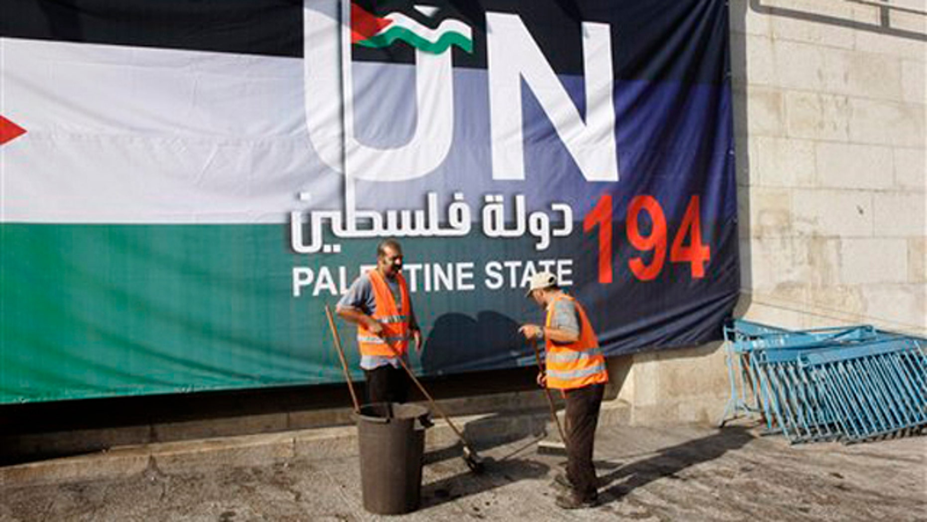 Palestinian municipality workers clean a street during a rally to support the Palestinian statehood bid in the United Nations, in the West Bank town of Bethlehem Sept. 18.