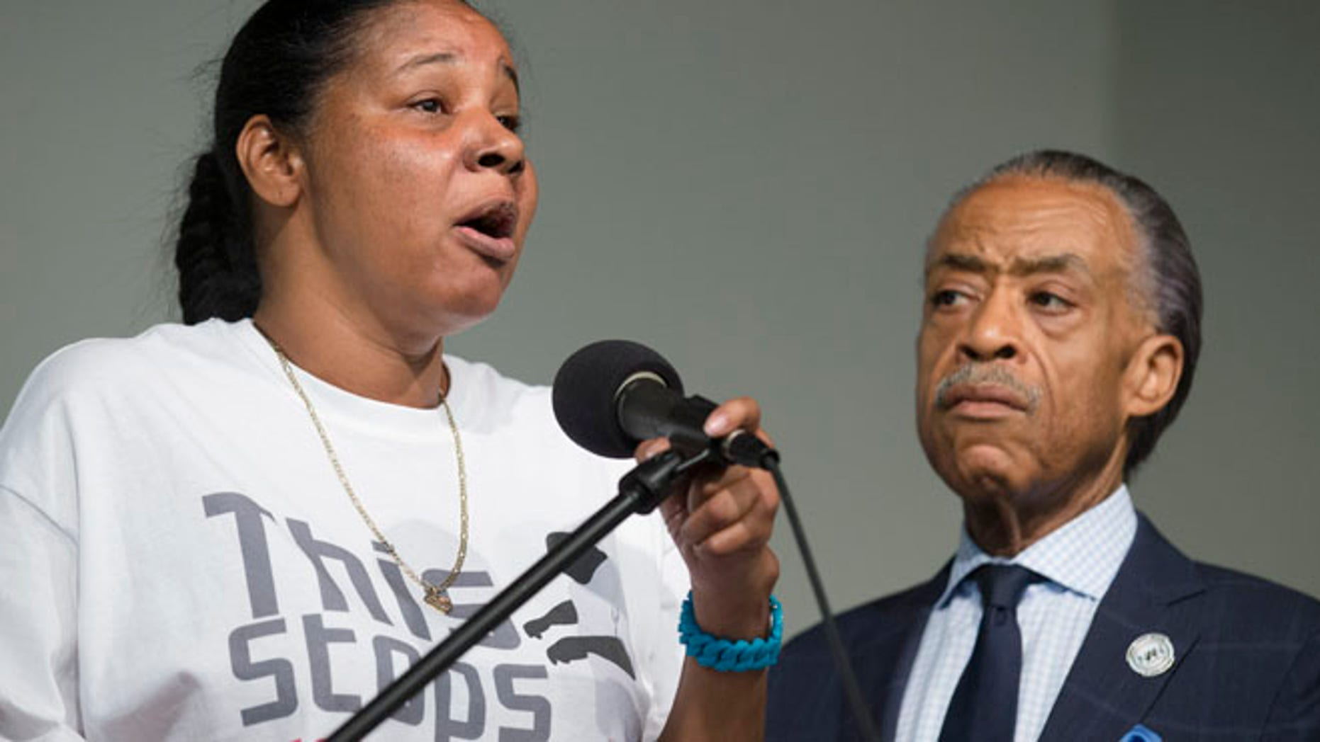 July 26, 2014: Esaw Garner, wife of Eric Garner, left, speaks alongside the Rev. Al Sharpton during a rally at the National Action Network headquarters in New York.