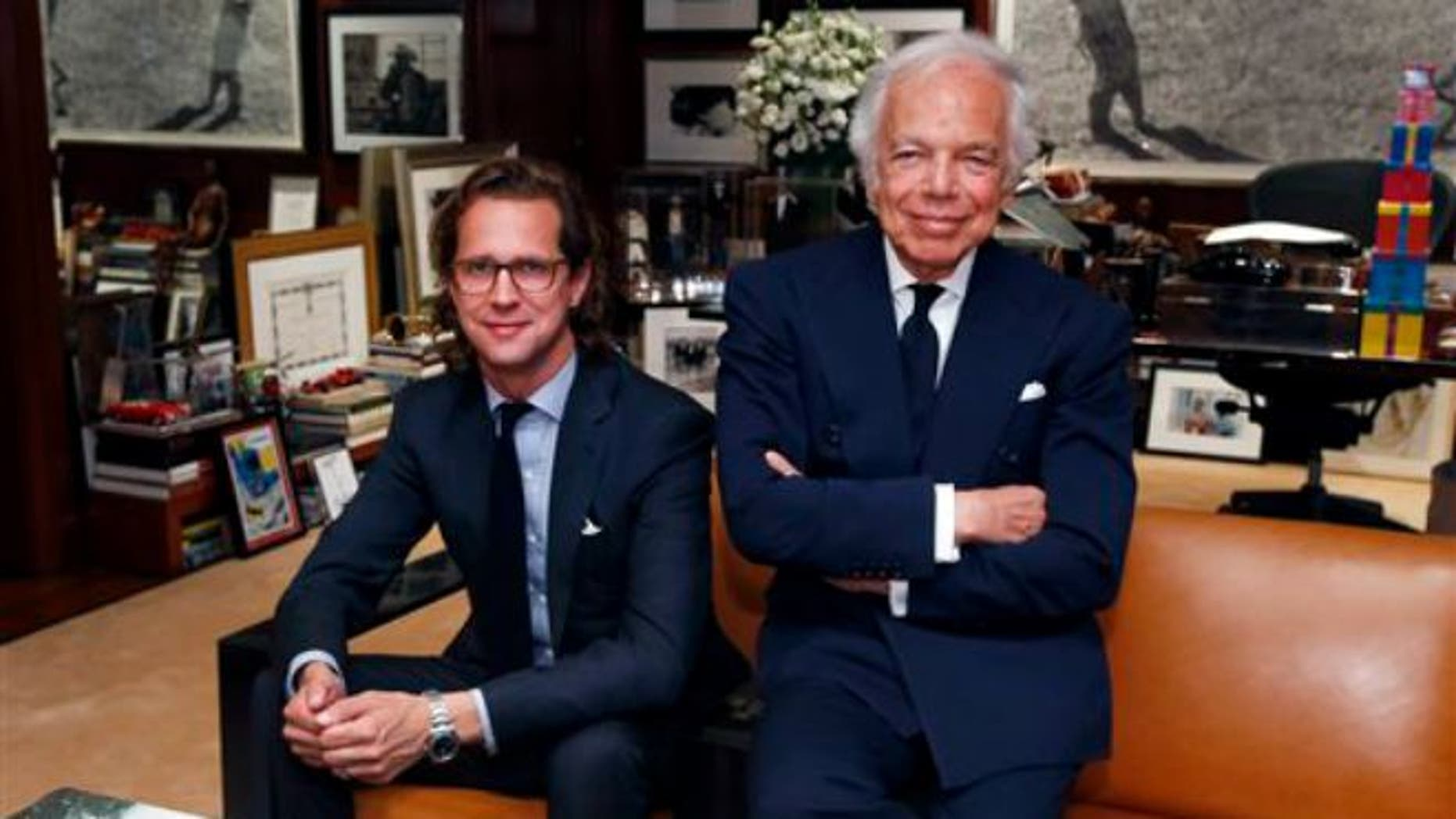 Sept. 29, 2015: Designer Ralph Lauren, right, poses in his office with Stefan Larsson, global brand president for Old Navy, in New York. Lauren is stepping down as CEO of the fashion and home decor empire that he founded nearly 50 years ago, and Larsson, who has been the global president of Old Navy for three years, will succeed him.