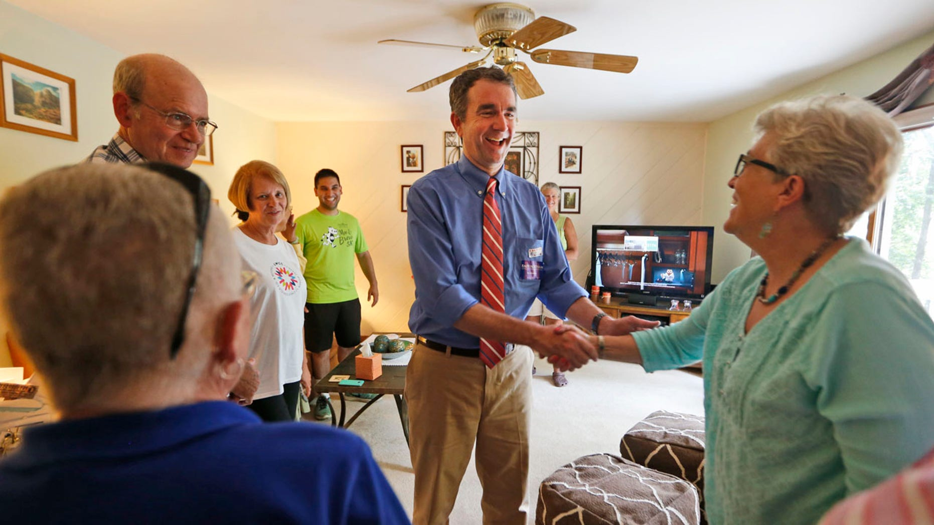 Democratic candidate for governor, Lt. Gov. Ralph Northam greets voters at a canvas kickoff Tuesday, June 13, 2017, in Chesterfield, Va. Lt. Gov Ralph Northam faces former Congressman Tom Perriello in today's primary. (AP Photo/Steve Helber)