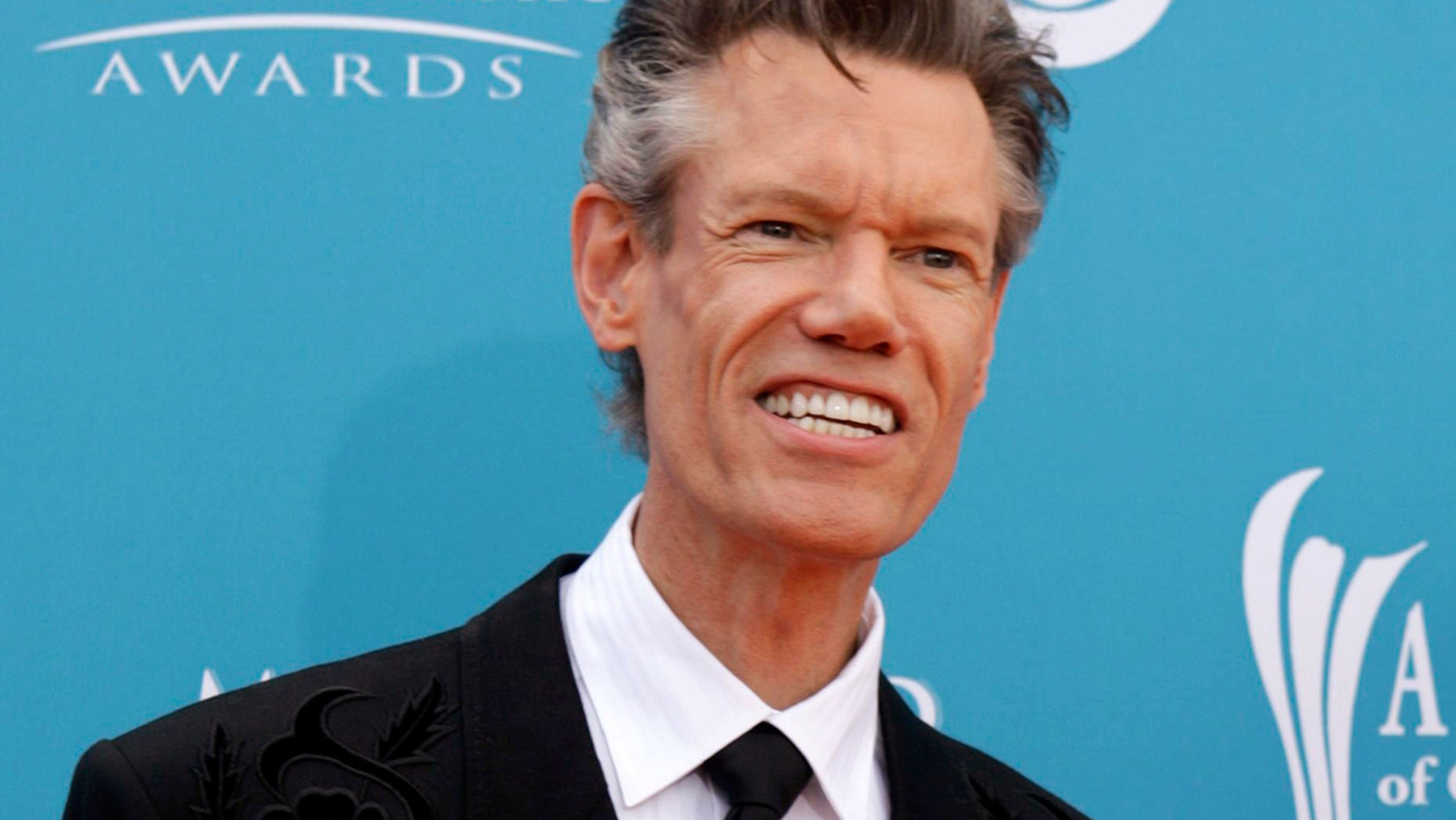 Singer Randy Travis arrives at the 45th annual Academy of Country Music Awards in Las Vegas, Nevada April 18, 2010.  REUTERS/Steve Marcus (UNITED STATES - Tags: ENTERTAINMENT PROFILE) - GM1E64J0HFS01