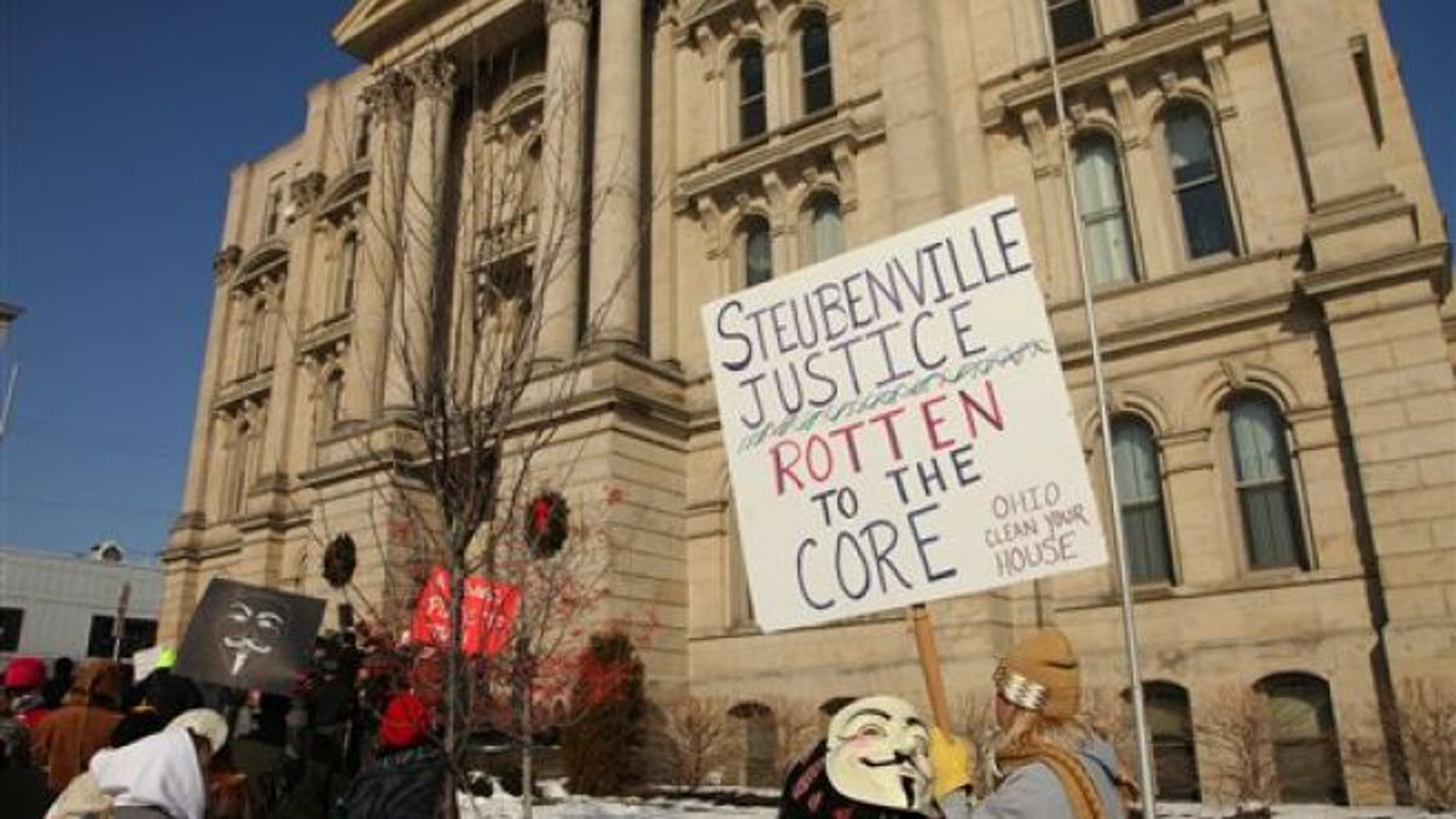 FILE: Jan. 5, 2013: Activists from the online group KnightSec and Anonymous protest at the Jefferson County Courthouse in Steubenville, Ohio, over what they contend is a cover-up in a case involving the alleged rape of a teenage girl by Steubenville High School student-athletes that reportedly occurred in 2012.