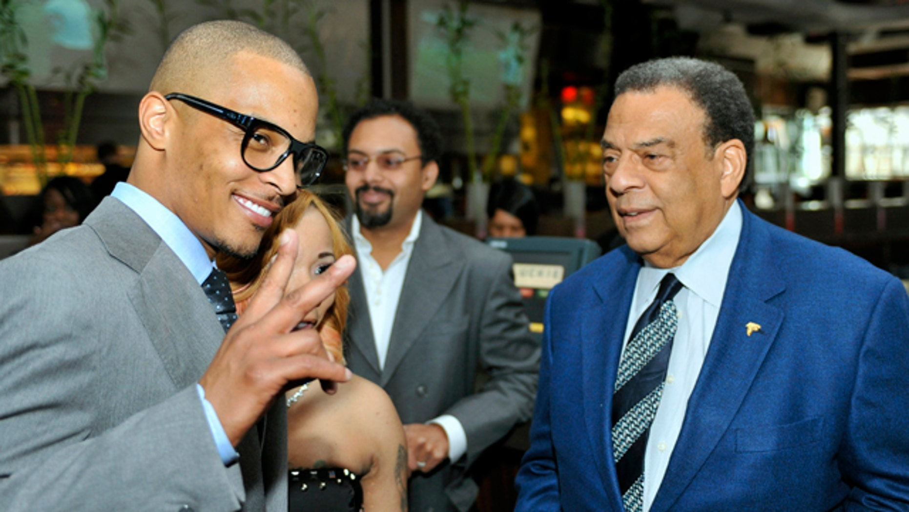 """Oct. 3, 2010: Grammy award winning artist Clifford """"TI"""" Harris, left, poses for photographers as he speaks with former Congressman and U.N. ambassador Andrew Young, right, during a recent Alzheimers benefit in Atlanta."""