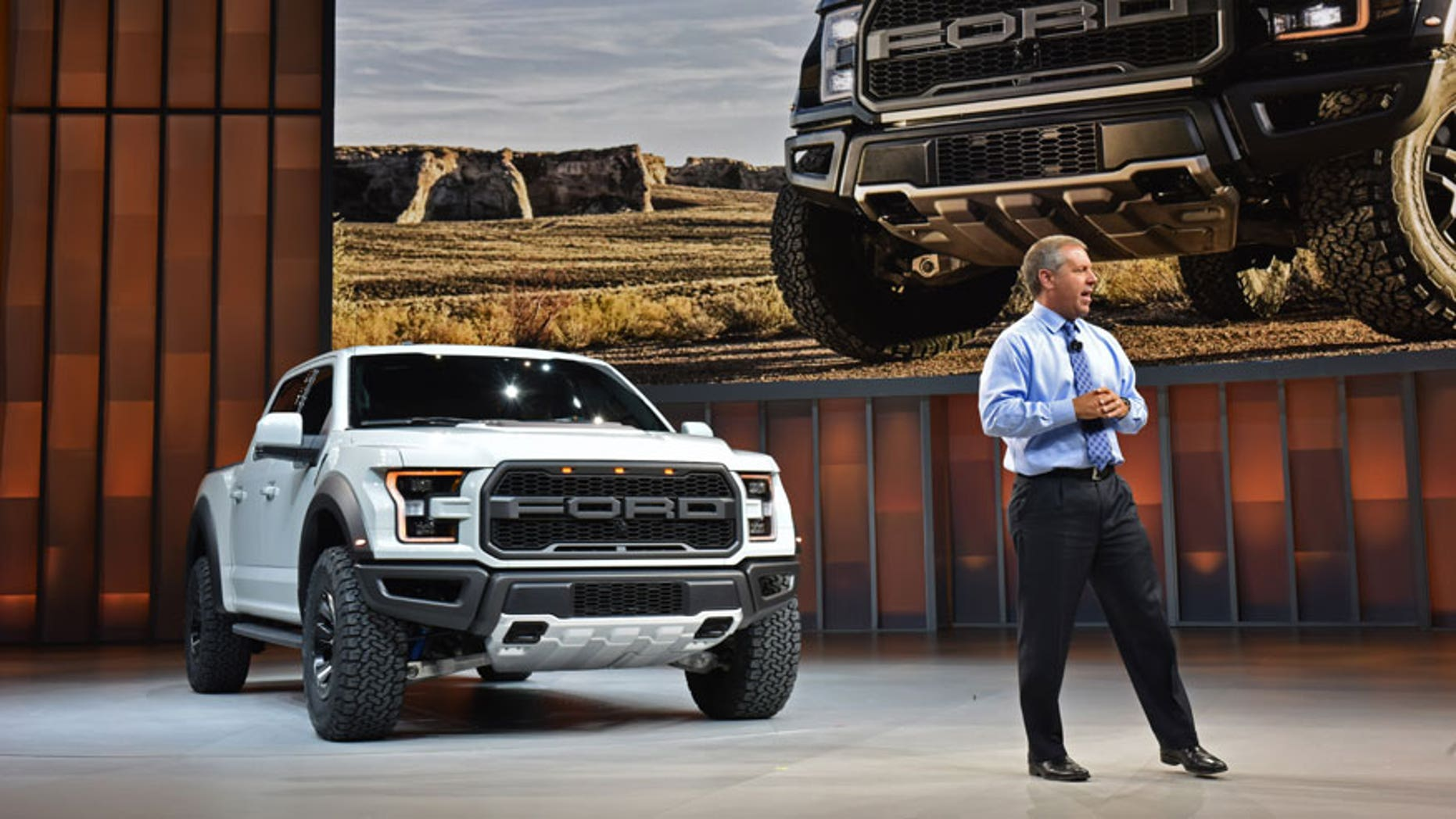 Ford President of the Americas, Joe Hinrichs, and the 2017 Ford F-150 Raptor SuperCrew