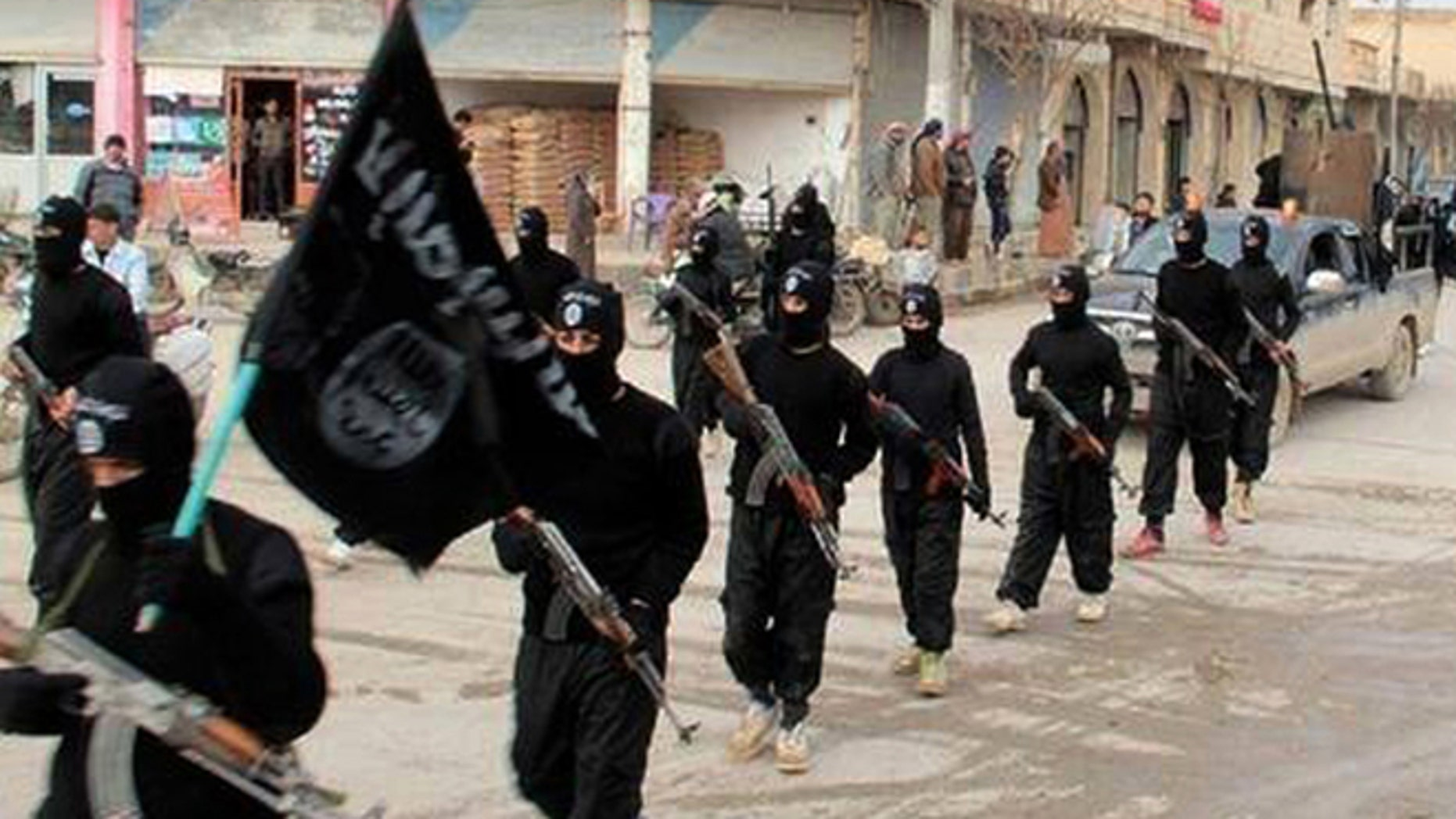 ISIS fighters march in Raqqa, Syria.