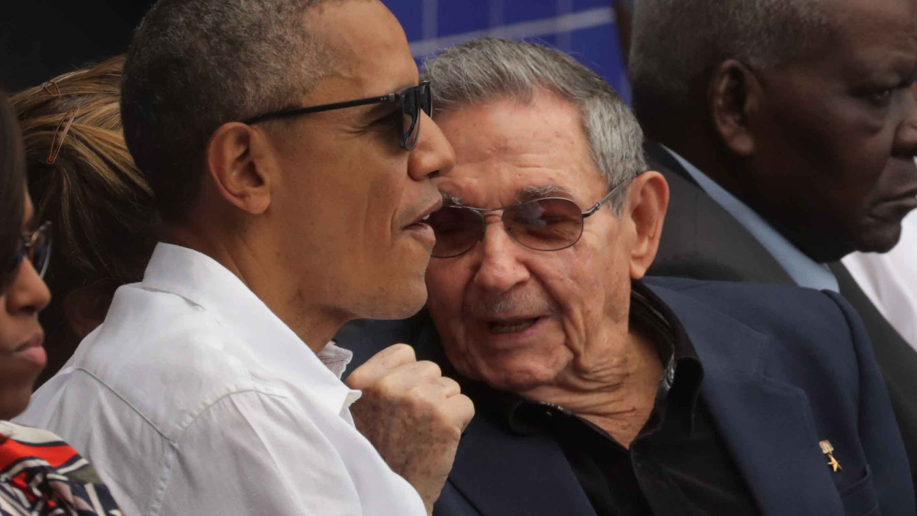 HAVANA, CUBA - MARCH 22:  U.S. President Barack Obama (L) and Cuban President Raul Castro talk during an exposition game between the Cuban national baseball team and Major League Baseball's Tampa Bay Devil Rays at the Estado Latinoamericano March 22, 2016 in Havana, Cuba. This is the first time a sittng president has visited Cuba in 88 years.  (Photo by Chip Somodevilla/Getty Images)