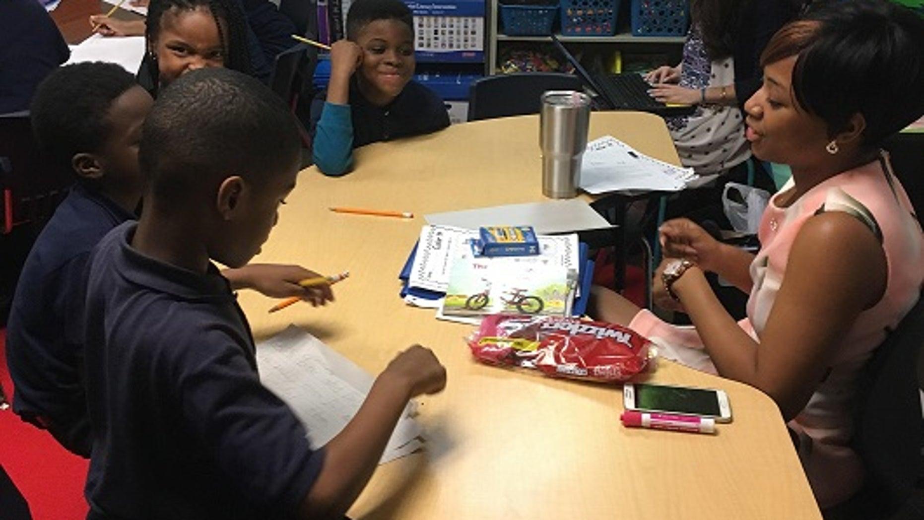 18-year-old Raven Osborne teaching elementary school children at 21st Century Charter School in Gary, Indiana on April 25, 2017.