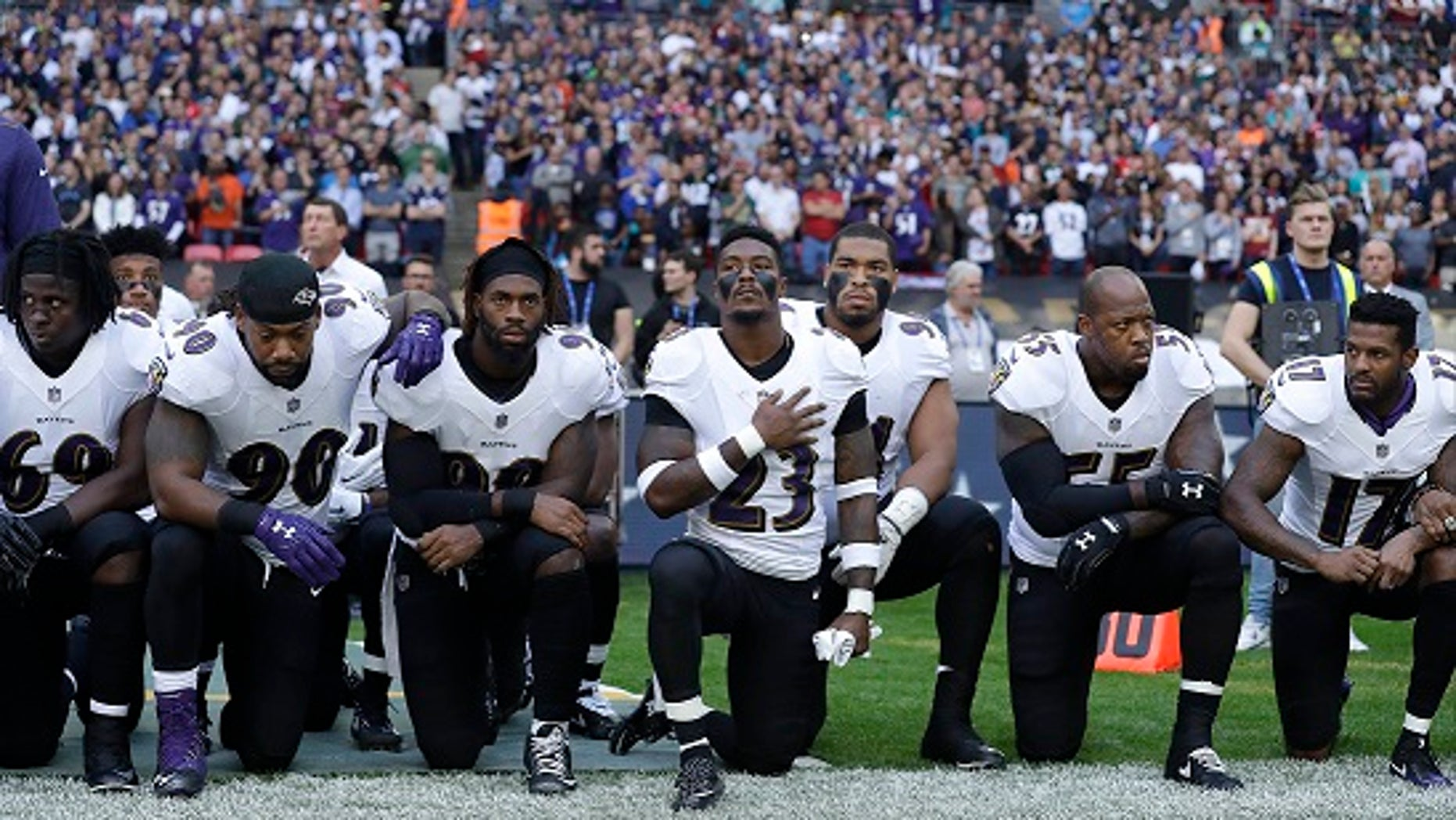 Baltimore Ravens players knelt during the playing of the U.S. national anthem on Sunday.