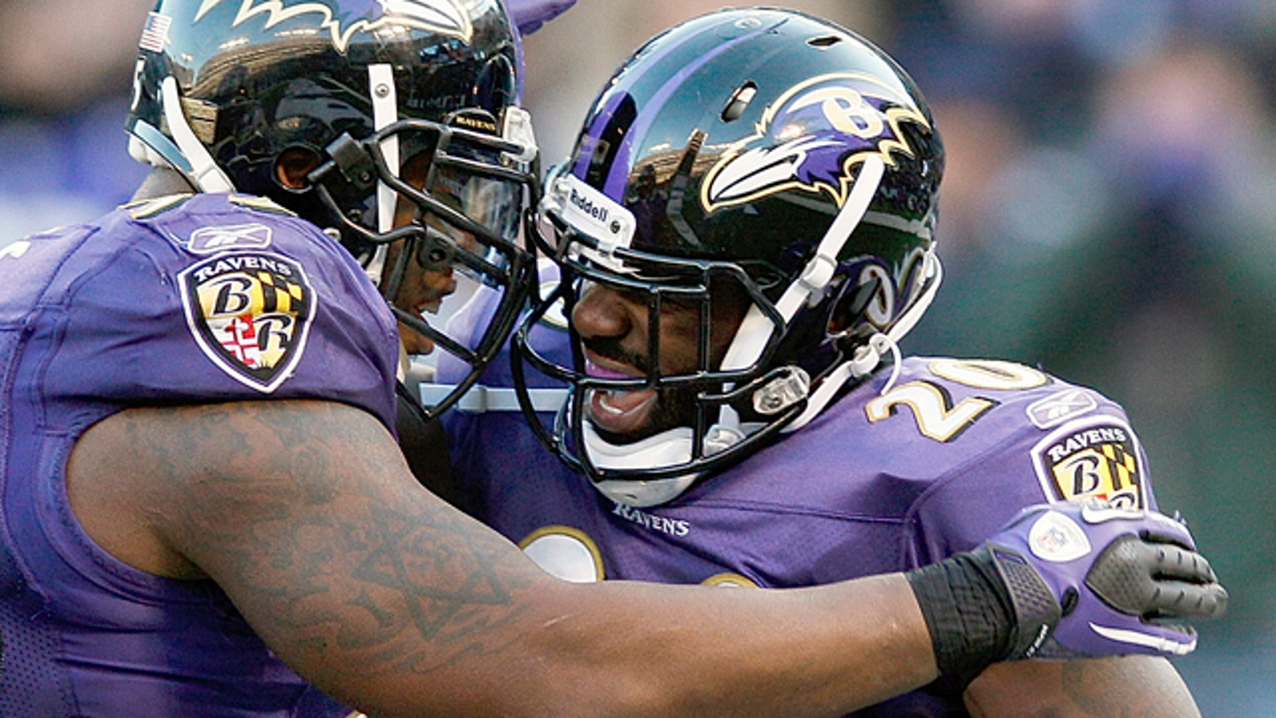 Jan. 15, 2012: Baltimore Ravens free safety Ed Reed, right, celebrates his interception with teammate outside linebacker Terrell Suggs during the second half of an NFL divisional playoff football game against the Houston Texans in Baltimore.