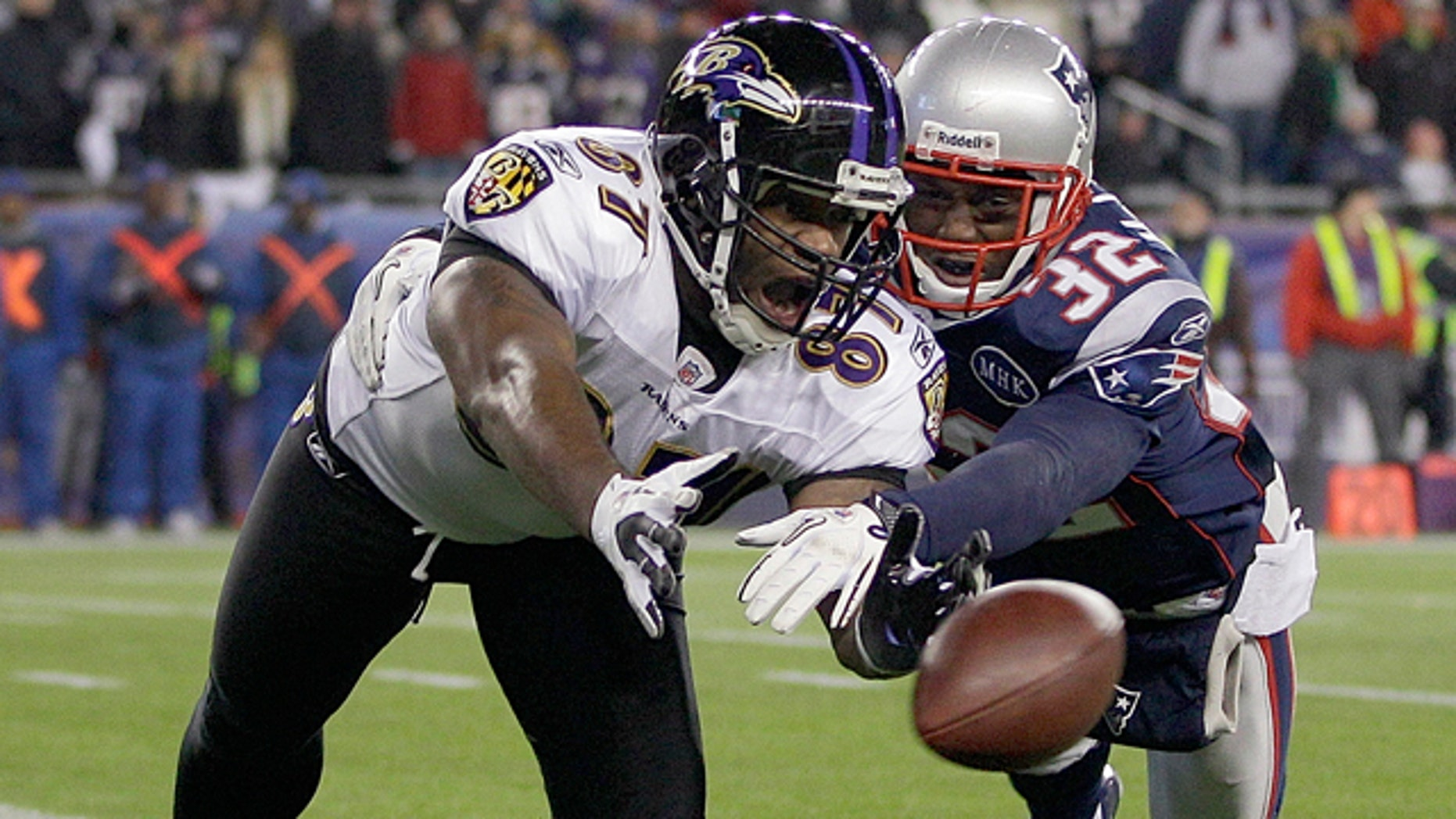 Jan. 22, 2012: Baltimore Ravens tight end Kris Wilson (87) is defended by New England Patriots cornerback Devin McCourty (32) as he tries to make a catch during the second half of the AFC Championship NFL football game in Foxborough, Mass.