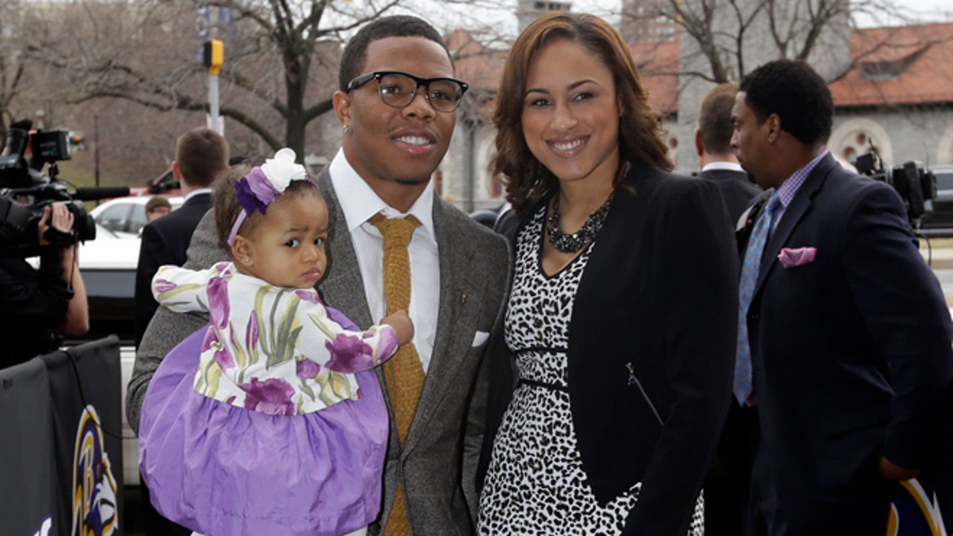 In this March 11, 2013 file photo, Baltimore Ravens running back Ray Rice, left, poses with his daughter, Rayven, and Janay Palmer as they arrive for a screening of a new film released on DVD that chronicles the team's championship NFL football season in Baltimore. Police in Atlantic City say Ray Rice and his fiance, Janay Palmer, were released on Saturday, Feb. 15, 2014, after they were arrested when an argument turned physical at the Revel Casino.