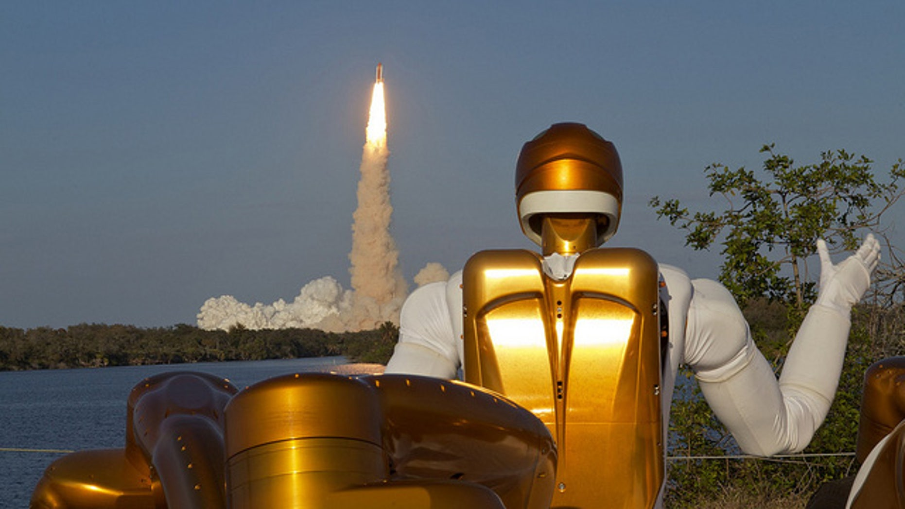 Robonaut R2A waving goodbye as Robonaut R2B launches into space aboard STS-133. R2 is the first humanoid robot in space.