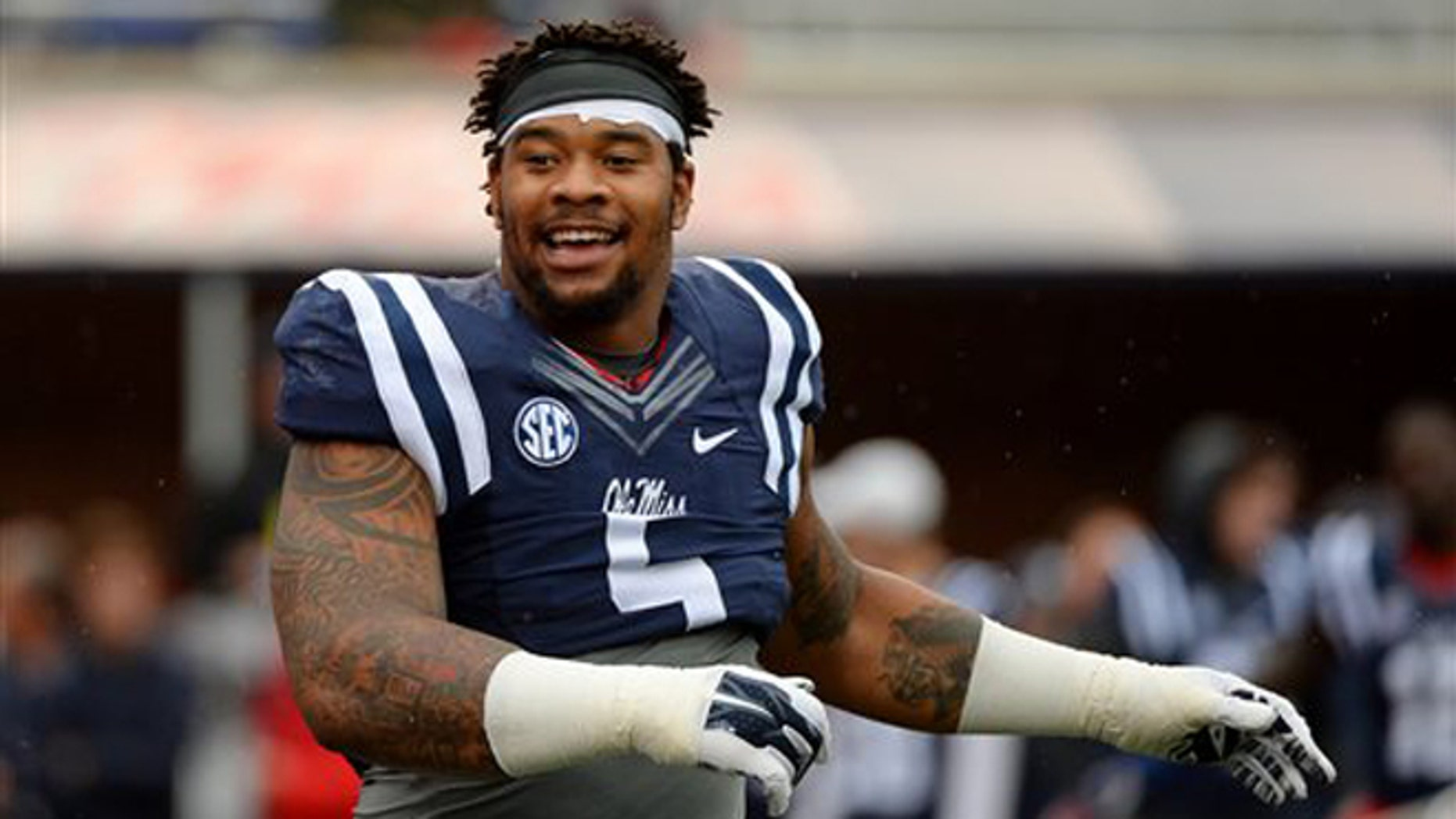 Nov. 7, 2015: Mississippi defensive tackle Robert Nkemdiche stretches before an NCAA college football game against Arkansas in Oxford, Miss. (AP Photo/Thomas Graning)