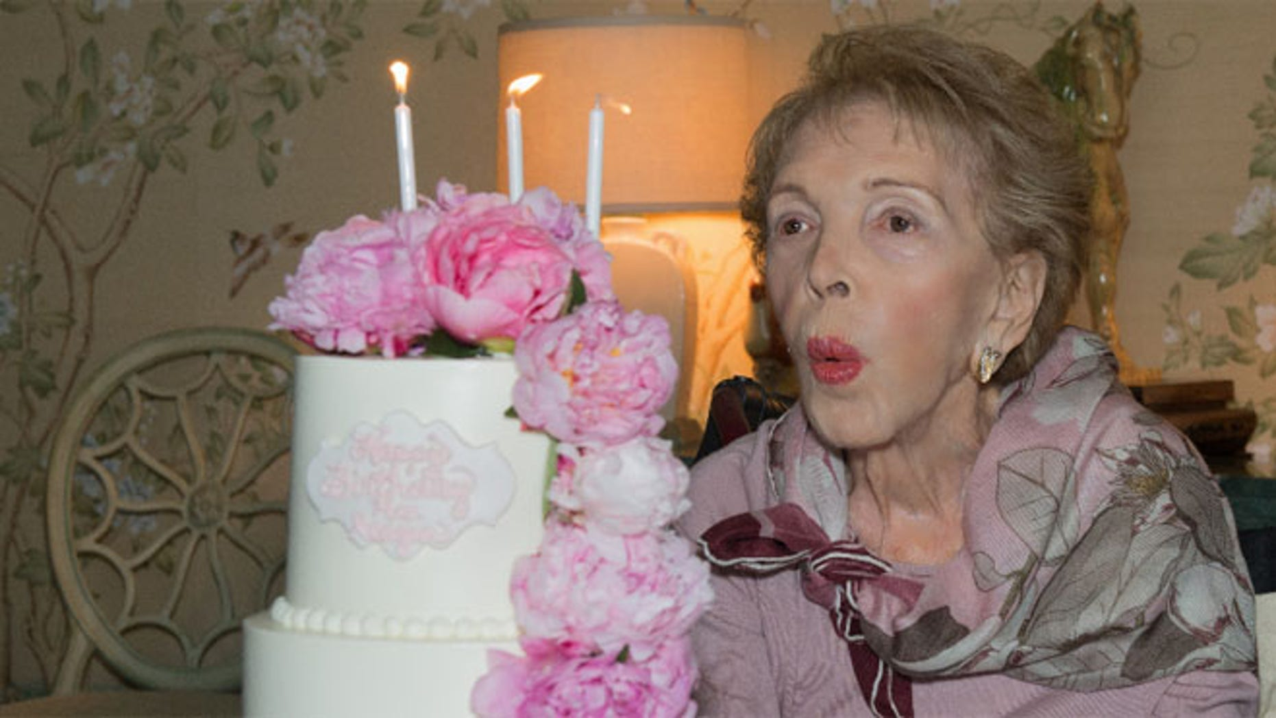 Nancy Reagan blows out her birthday candles on her 94th birthday on July 6, 2015.<br>