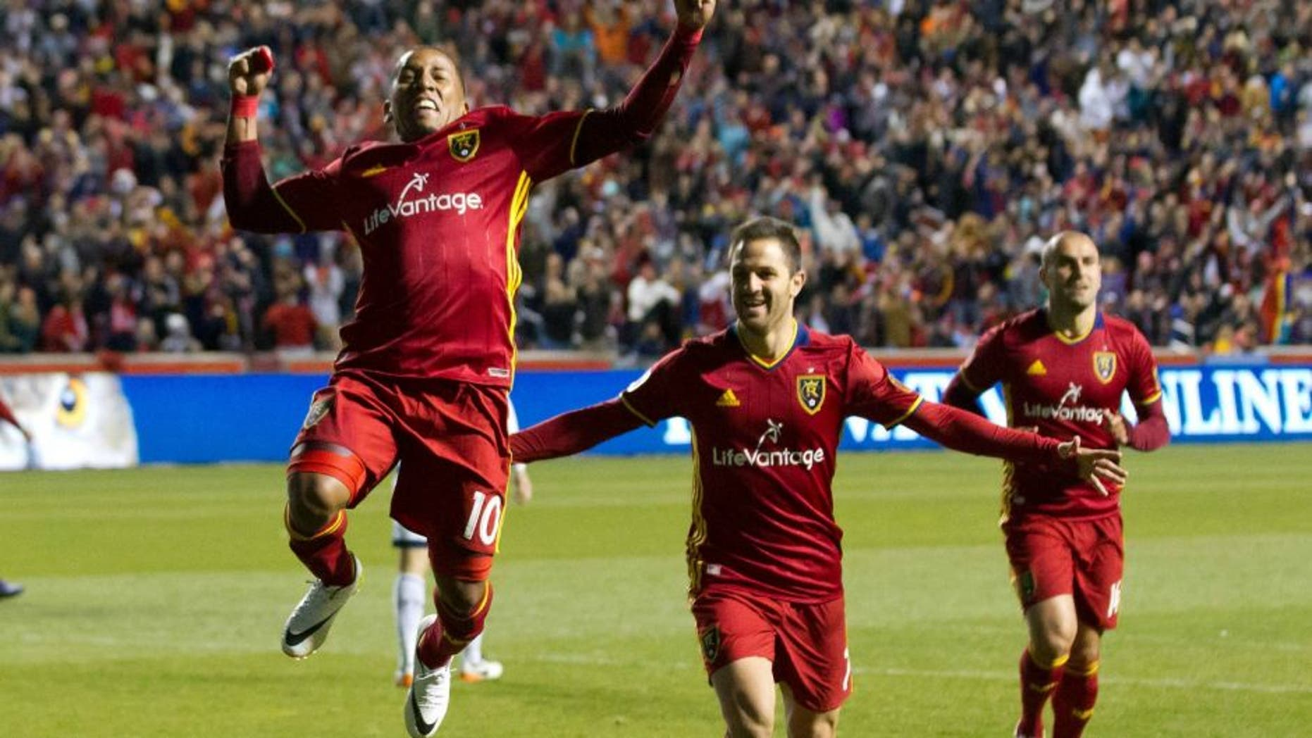 Apr 16, 2016; Sandy, UT, USA; Real Salt Lake forwards Juan Manuel Martinez (right) and Joao Plata (10) celebrate a goal during the second half against the Vancouver Whitecaps at Rio Tinto Stadium. Real Salt Lake won 1-0. Mandatory Credit: Russ Isabella-USA TODAY Sports