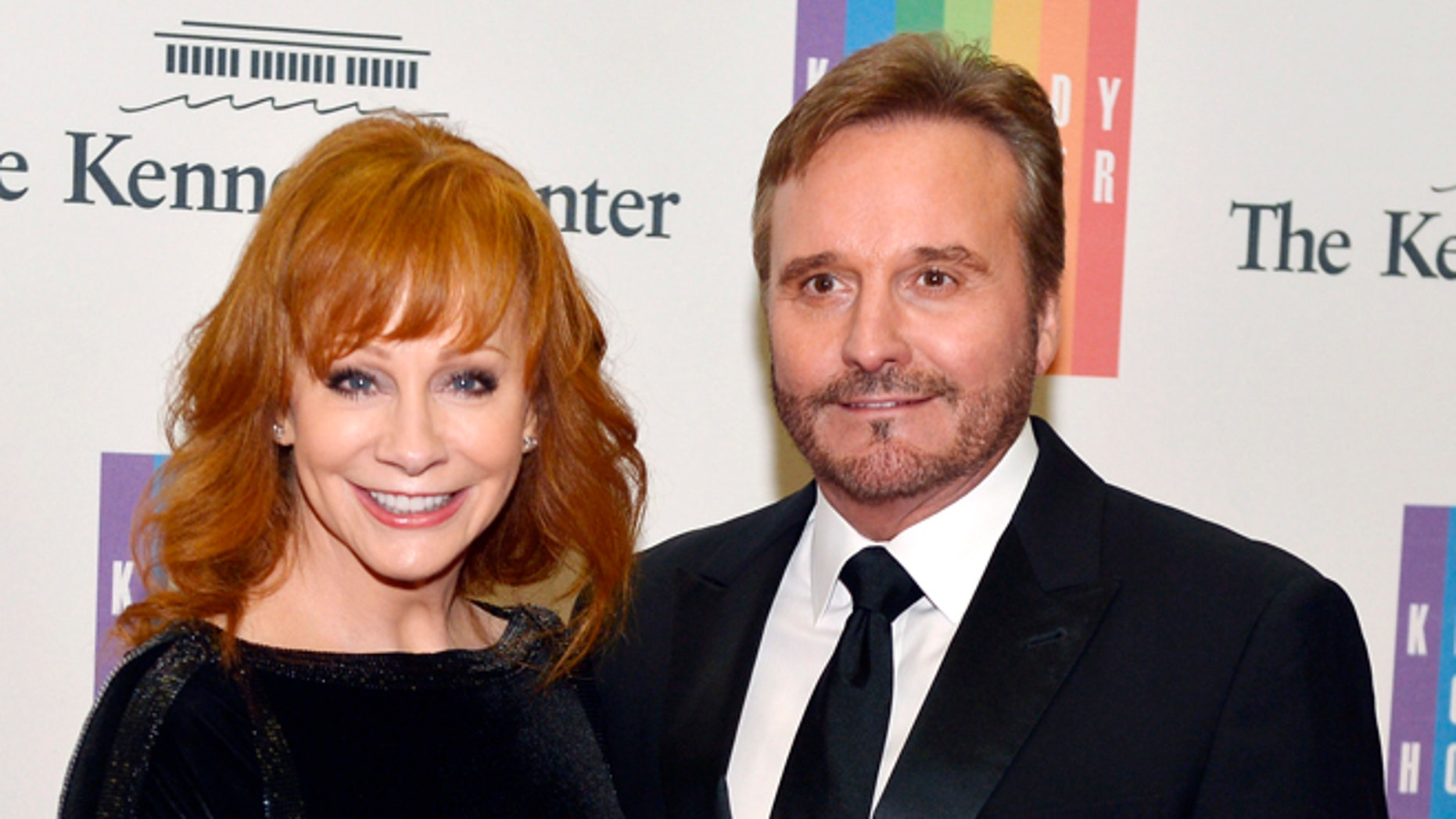 December 6, 2014. Country singer Reba McEntire and her husband Narvel Blackstock pose on the red carpet as they arrive ahead of the 37th Annual Kennedy Center gala dinner.