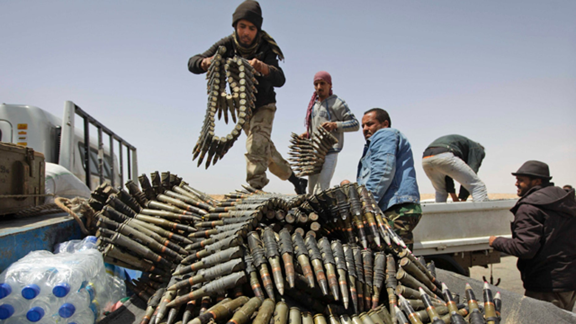 April 16, 2011: Libyan rebel fighters load a truck with ammunition on the outskirts of Ajdabiya, Libya