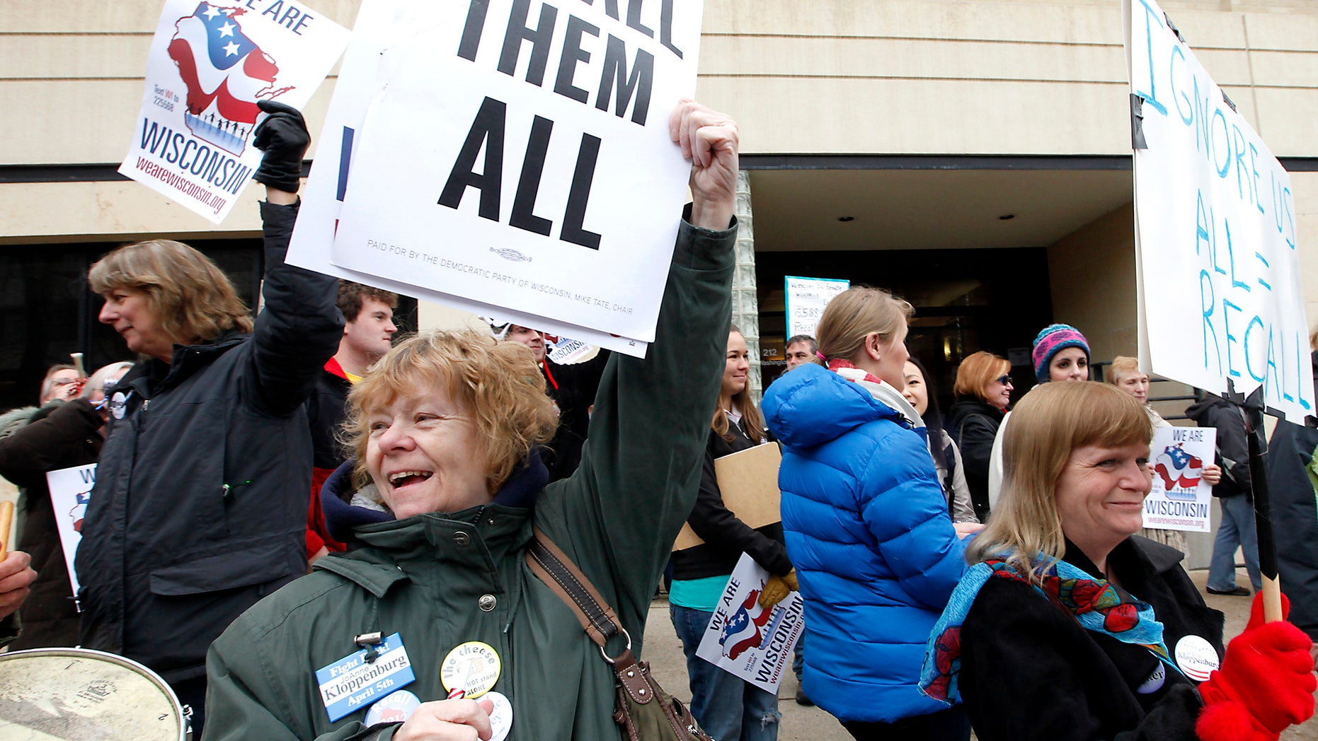 This April 1, 2011 file photo shows Chris Taylor, left, and Peppi Elder, right, joining demonstrators calling for the recall of State Sen. Dan Kapanke, R-LaCrosse, outside the Wisconsin Government Accountability Board in Madison, Wis. (AP)