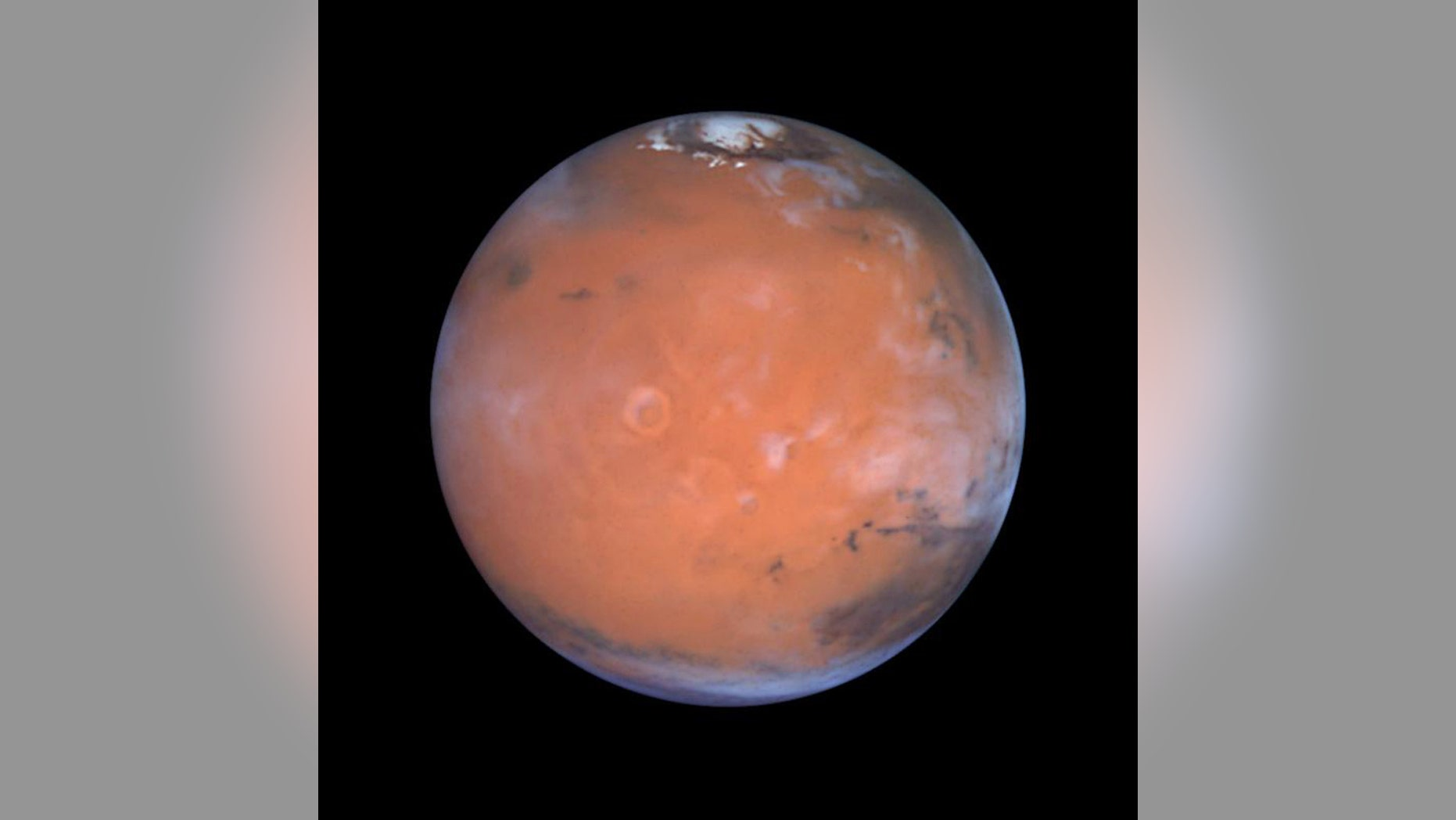 New research into old data suggests that ice may hide around Mars' equator. Here, the Red Planet is seen in a vivid Hubble view.