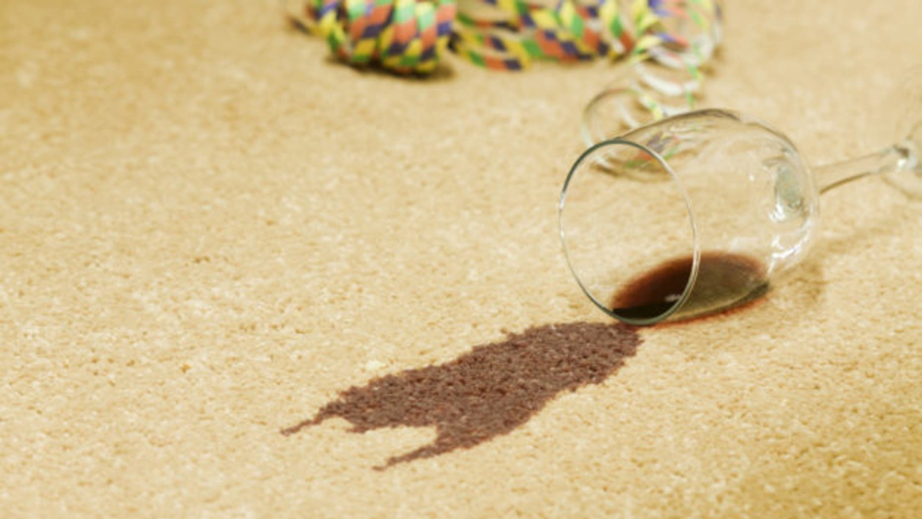 Red wine spilled on a beige carpet.