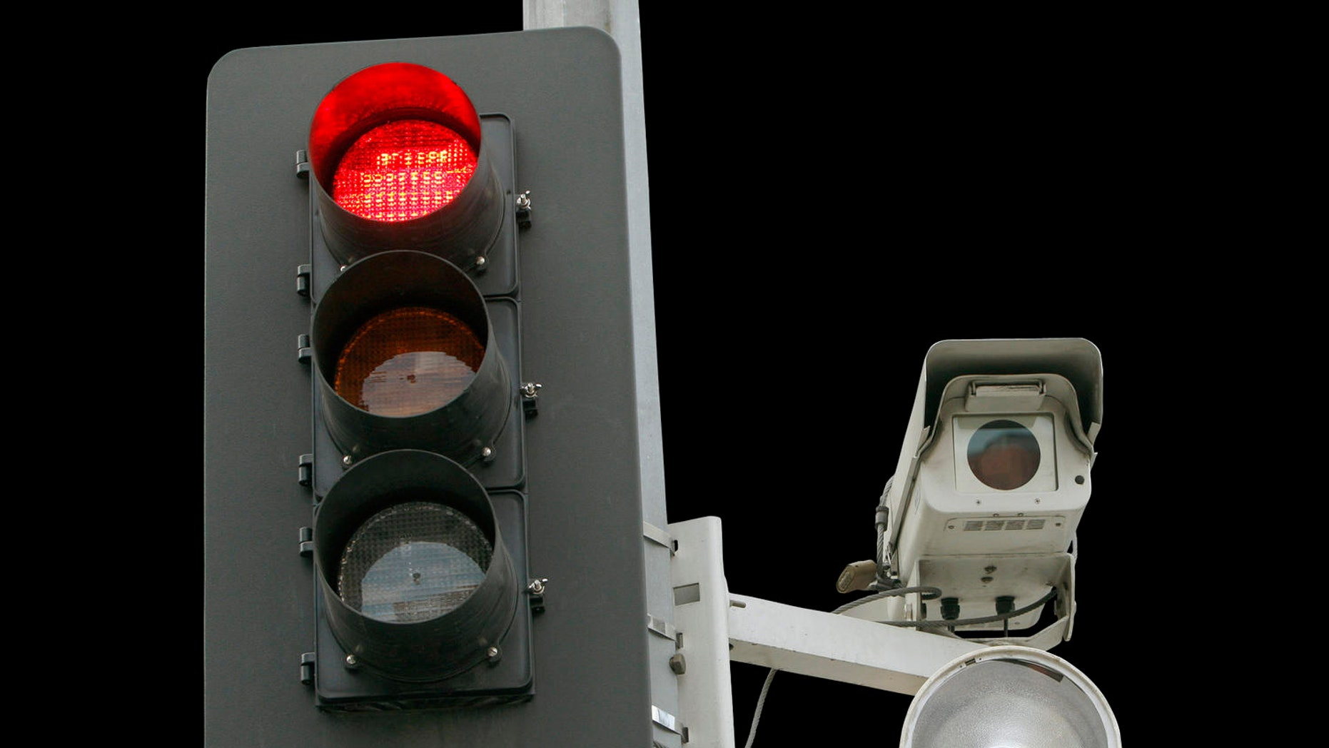 A red light camera setup is shown Wednesday Sept. 29, 2010 in Los Angeles. An audit by the Los Angeles city controller finds that red-light cameras haven't shown to improve public safety. The audit released Wednesday blames police for not adequately compiling statistics at the 32 intersections where red light cameras are installed, making it difficult to conclude whether they are effective. (AP Photo/Nick Ut)