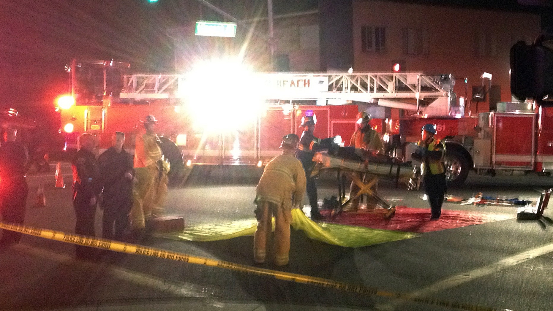 Dec. 17, 2014: n this photo provided by Mark Milutin, firefighters carry a victim from a triage area after a driver suspected of being intoxicated hit a group of pedestrians and another car outside a church as a Christmas service ended in the Los Angeles suburb of Redondo Beach, Calif.