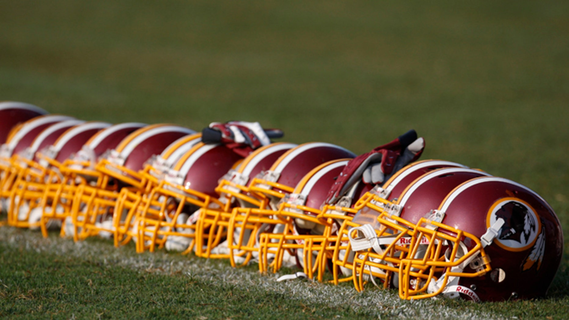 Aug. 4, 2009: Washington Redskins helmets are displayed on the field during NFL football training camp at Redskins Park in Ashburn, Va. (AP/Pablo Martinez Monsivais, File)