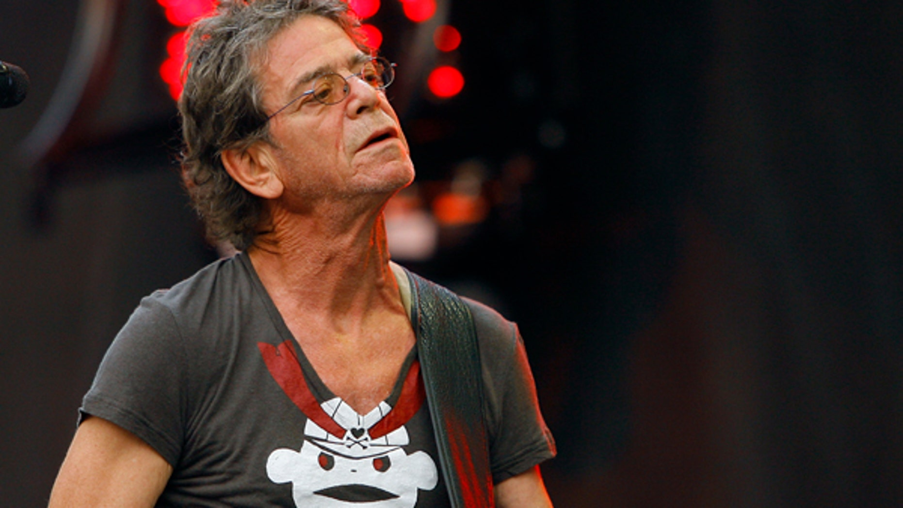 FILE - In this Sunday, Aug. 9, 2009 file photo, Lou Reed performs at the Lollapalooza music festival, in Chicago. The New York Public Library for the Performing Arts has acquired the complete archives of Lou Reed. The library and Reed's wife, musician Laurie Anderson, made the announcement Thursday, March 2, 2017, on what would have been his 75th birthday. (AP Photo/John Smierciak, File)