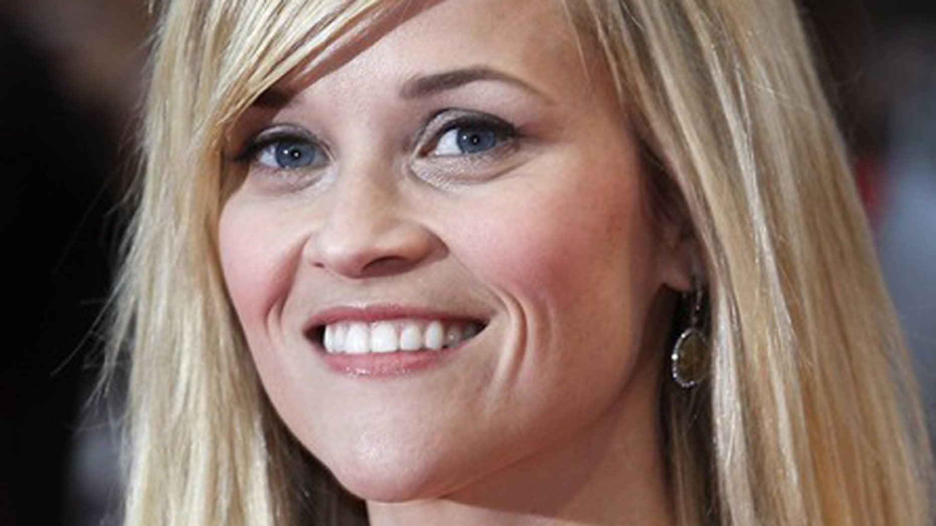Actress Reese Witherspoon poses for photographers at the premiere of Water for Elephants at the Westfield, in London May 3, 2011.