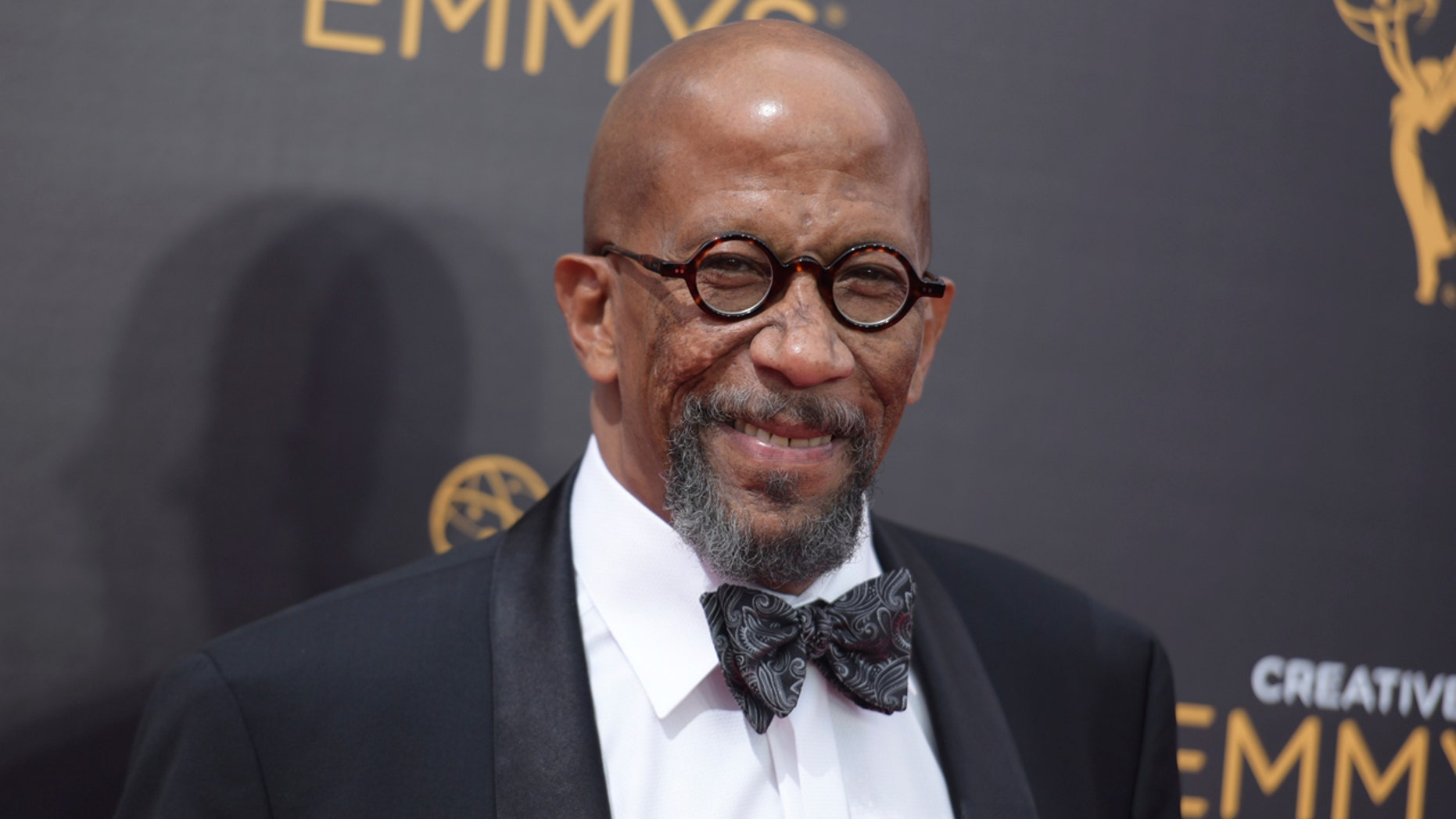 FILE - In this Sept. 10, 2016 file photo, Reg E. Cathey arrives at night one of the Creative Arts Emmy Awards at the Microsoft Theater in Los Angeles.