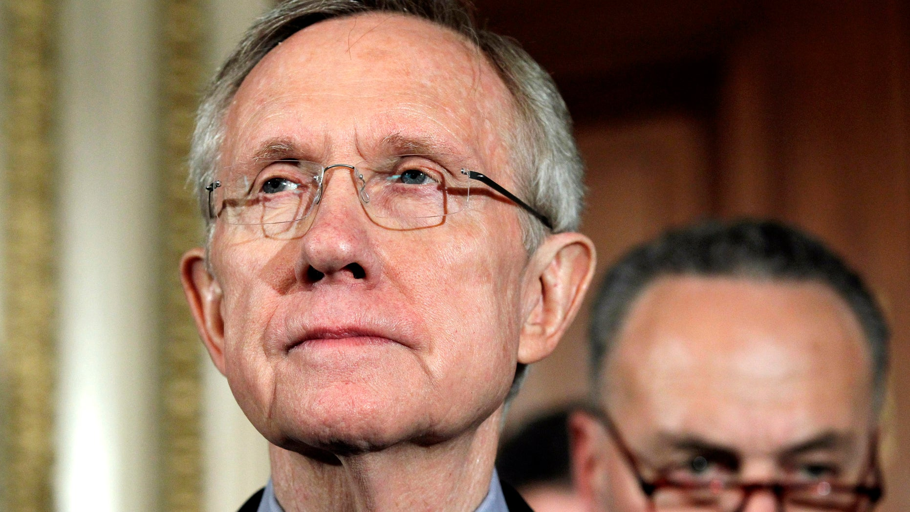 Senate Majority Leader Harry Reid of Nev., left, pauses during a news conference on Capitol Hill in Washington, Friday, April 8, 2011. (AP)