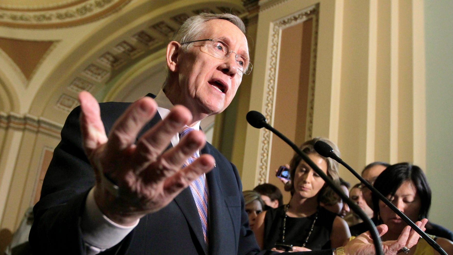 Senate Majority Leader Harry Reid of Nev. speaks with reporters about the conflicting plans to deal with the debt crisis, Tuesday, July 26, 2011, on the Hill Capitol in Washington.