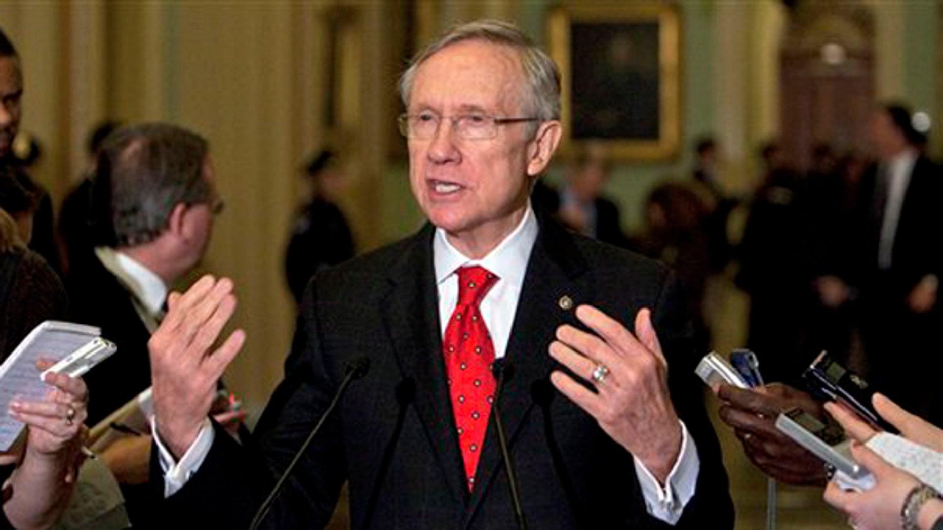 Senate Majority Leader Harry Reid talks to reporters in Washington Dec. 6. (AP Photo)