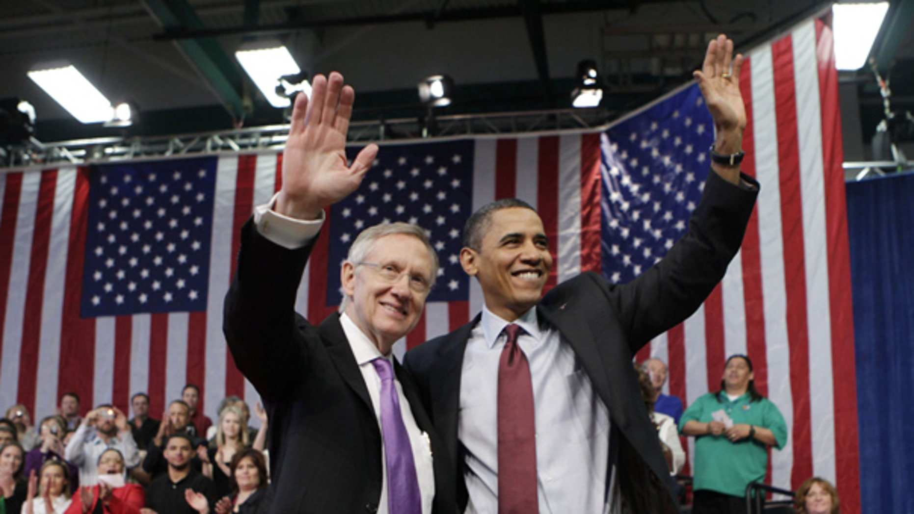 Feb. 19: President Obama and Senate Majority Leader Harry Reid wave following a town hall meeting in Henderson, Nev. (AP)