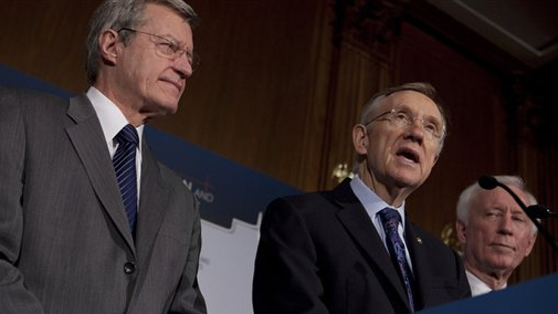 Monday: Sens. Max Baucus and Harry Reid were joined by American Medical Association President-elect Cecil Wilson to discuss the health insurance reform bill (AP Photo).