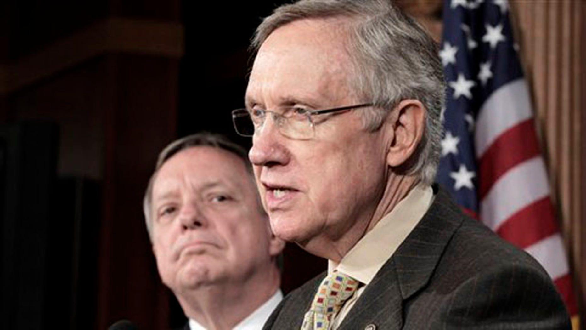 Senate Majority Leader Harry Reid, right, accompanied by Senate Majority Whip Richard Durbin, speaks to reporters on Capitol Hill June 30.