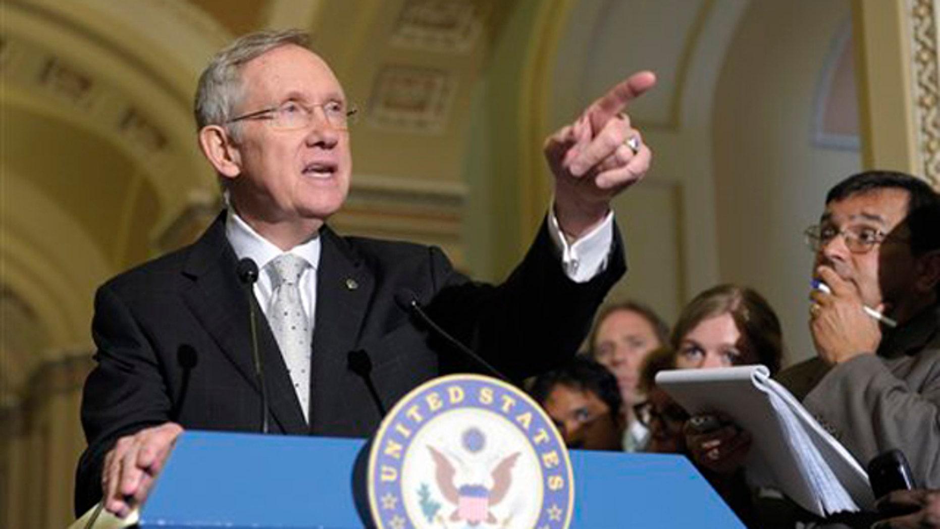 Senate Majority Leader Harry Reid speaks to reporters on Capitol Hill in Washington June 21.