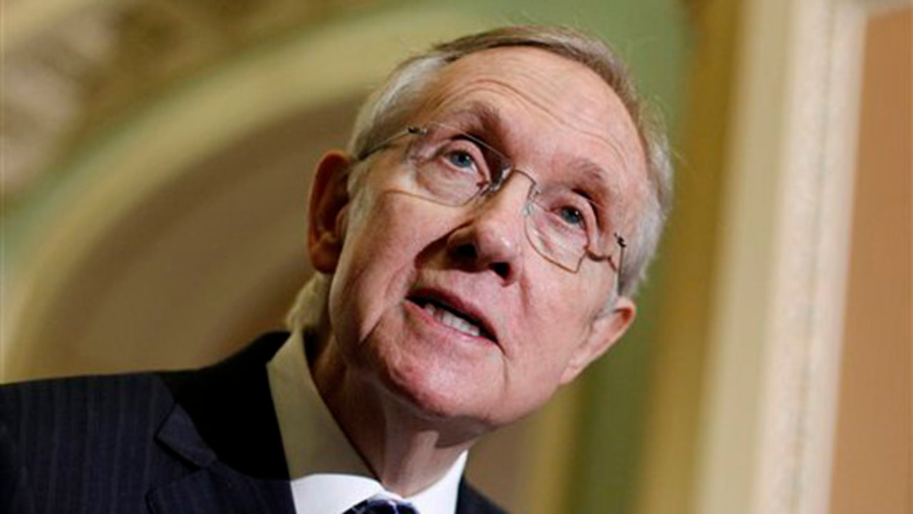 FILE: Senate Majority Leader Harry Reid talks to reporters Oct. 12 on Capitol Hill.