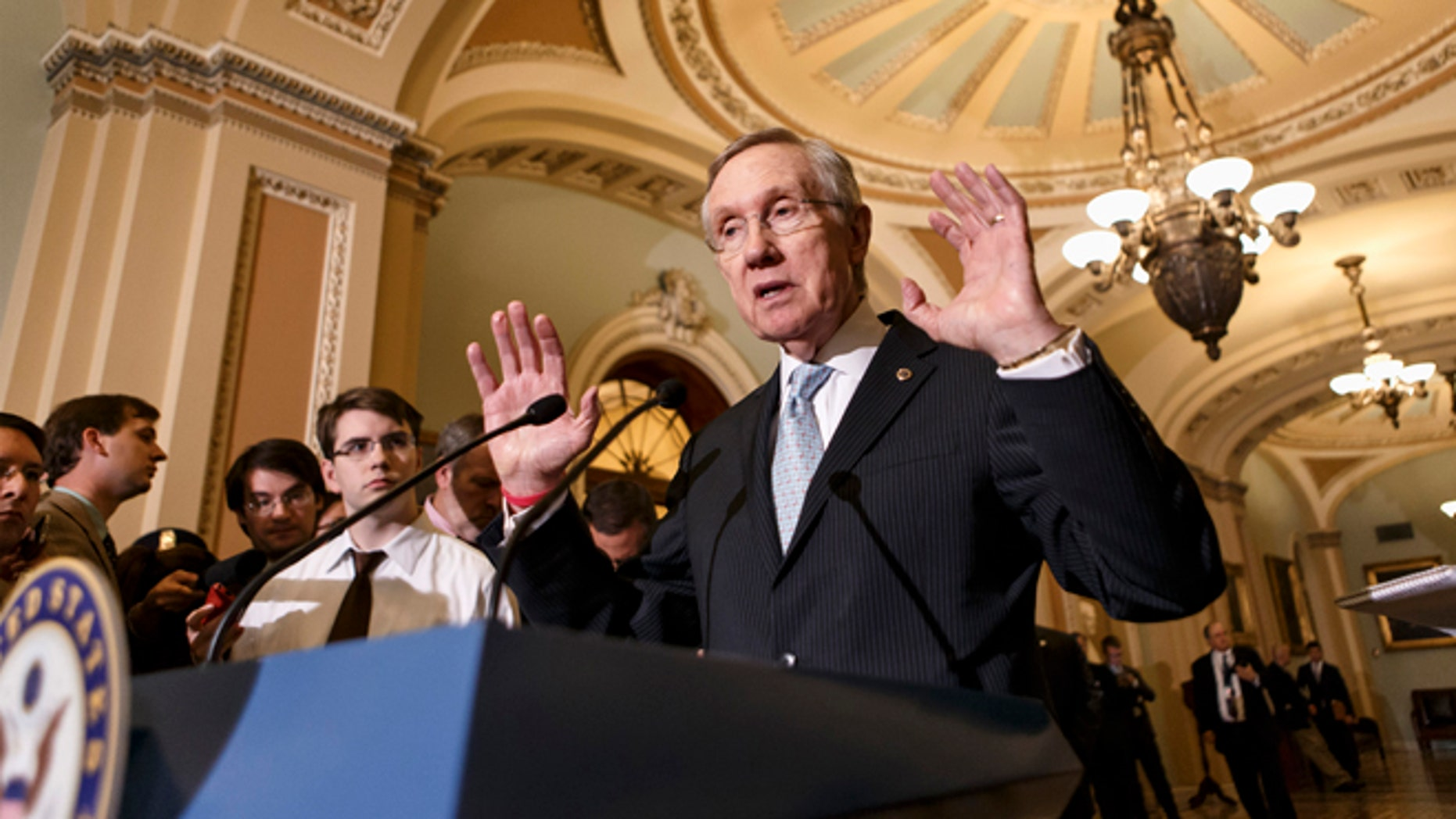 Sept. 24, 2013: Senate Majority Leader Harry Reid talks to reporters just off the Senate floor in Washington.
