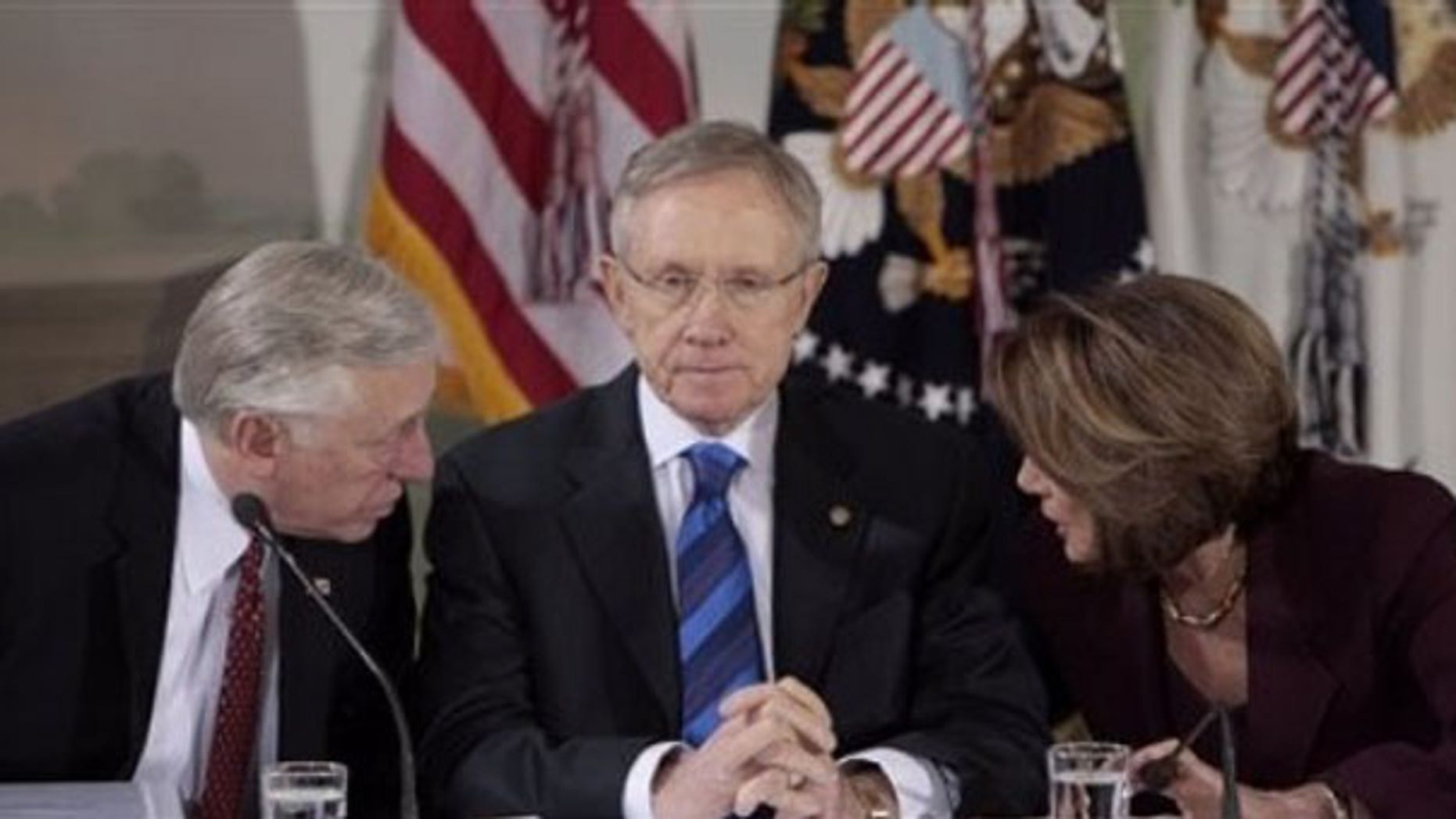 Senate Majority Leader Harry Reid, center, listens as House Majority Leader Steny Hoyer, left, talks to House Speaker Nancy Pelosi at a health care reform meeting Feb. 25 in Washington. (AP Photo)