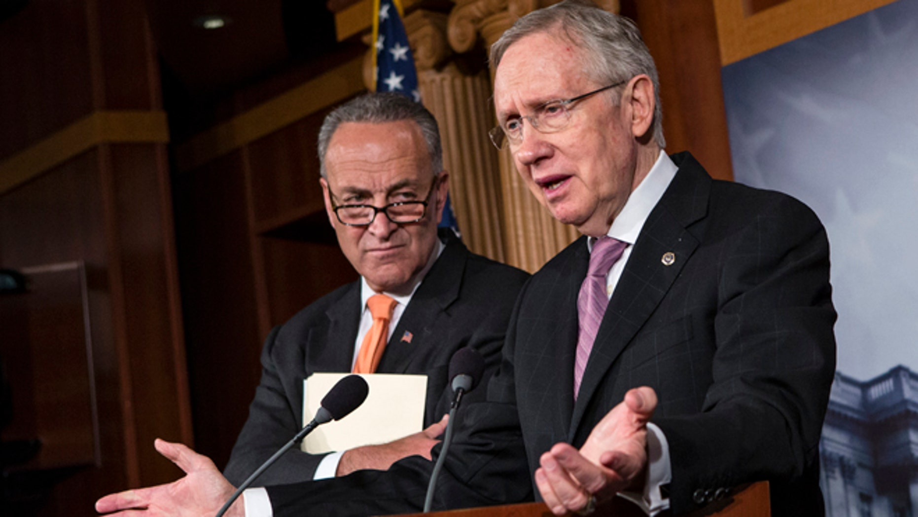 Oct. 2, 2013: Senate Majority Leader Harry Reid of Nev., right, accompanied by Sen. Charles Schumer, D-N.Y., speaks on Capitol Hill.