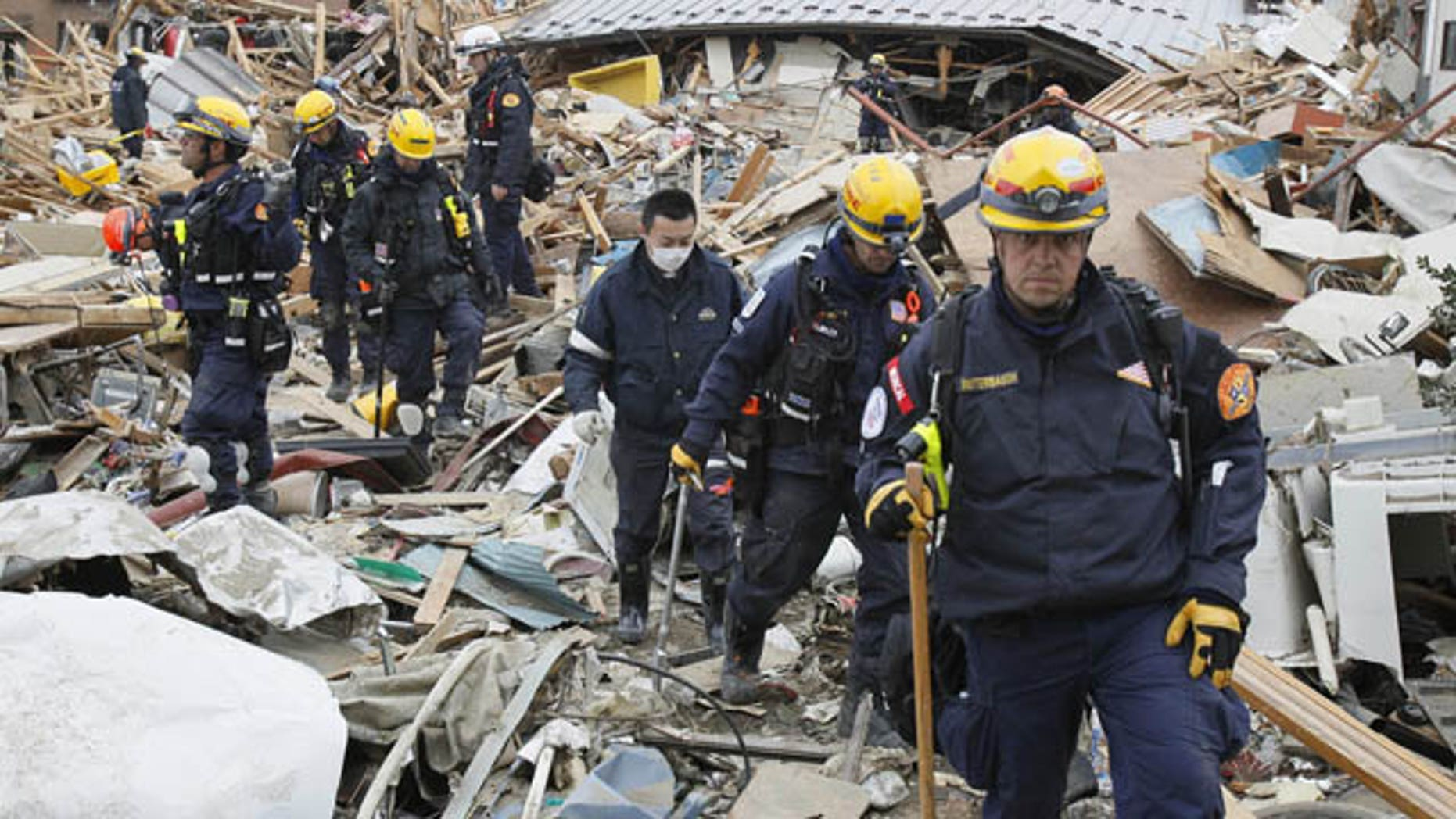 March 15: Members of a U.S. rescue team work in the rubble at the earthquake and tsunami devastated area in Ofunato, Iwate Prefecture, Japan, on Tuesday, four days after the devastation. (AP/Kyodo News)