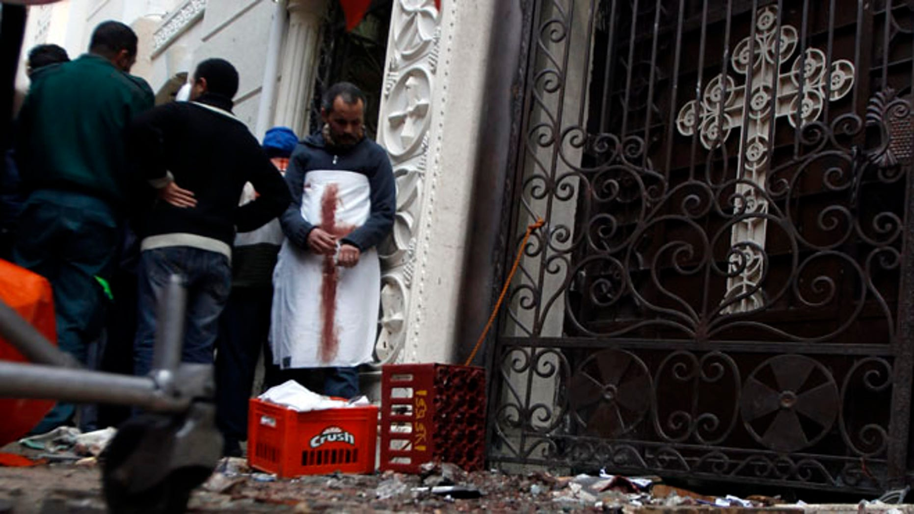 Egyptian Christians gather outside the Coptic Orthodox church after a car bomb attack, in Egypt's northern city of Alexandria, January 1, 2011.