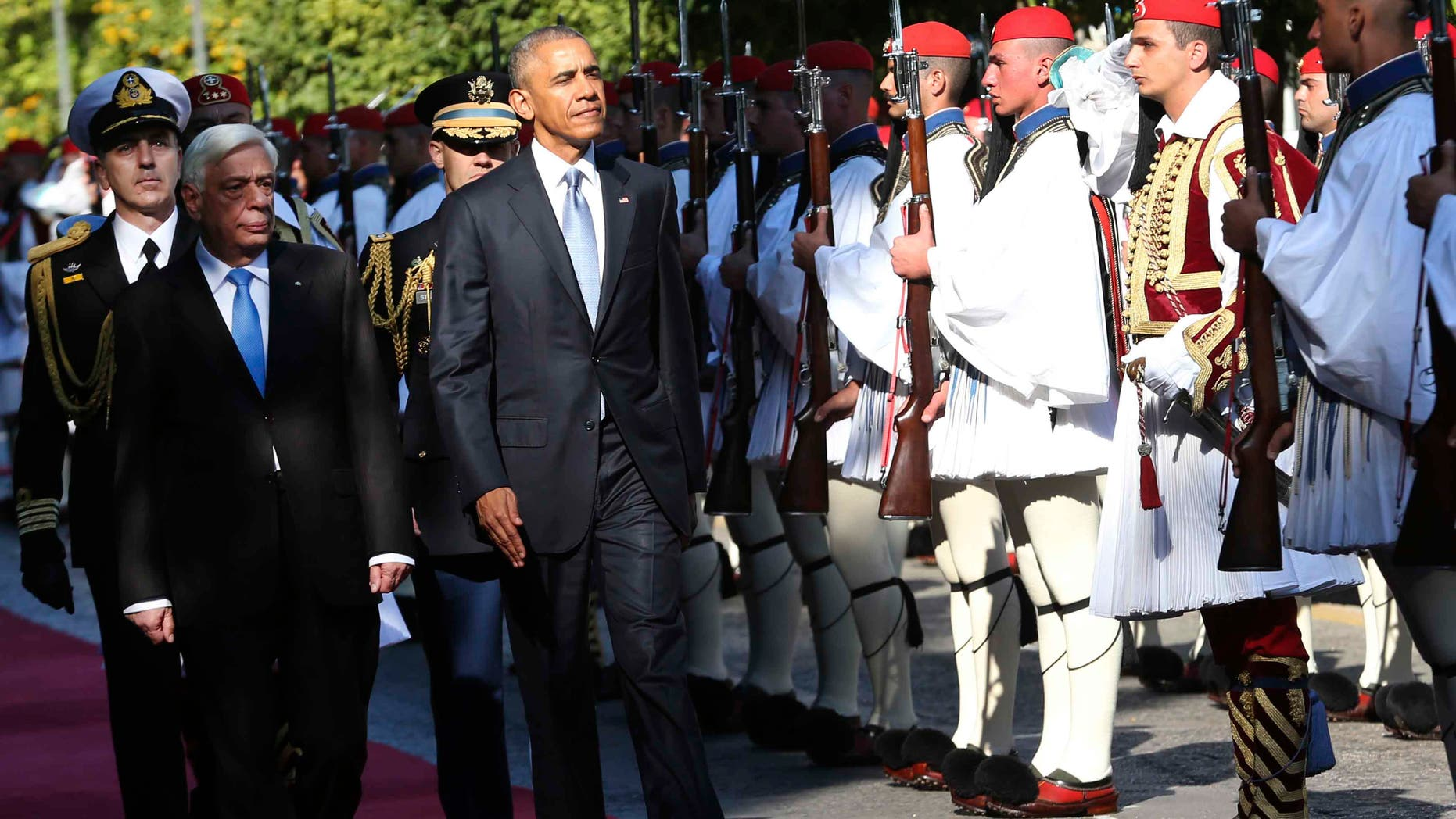 US President Barack Obama and his greek counterpart Prokopis Pavlopoulos review the Presidential Guard in Athens, Tuesday, Nov. 15, 2016. President Barack Obama arrived in Greece Monday morning on the first stop of his final foreign tour as president, the first visit to Greece by a sitting U.S. president since Bill Clinton in 1999 trip. (AP Photo/Lefteris Pitarakis)