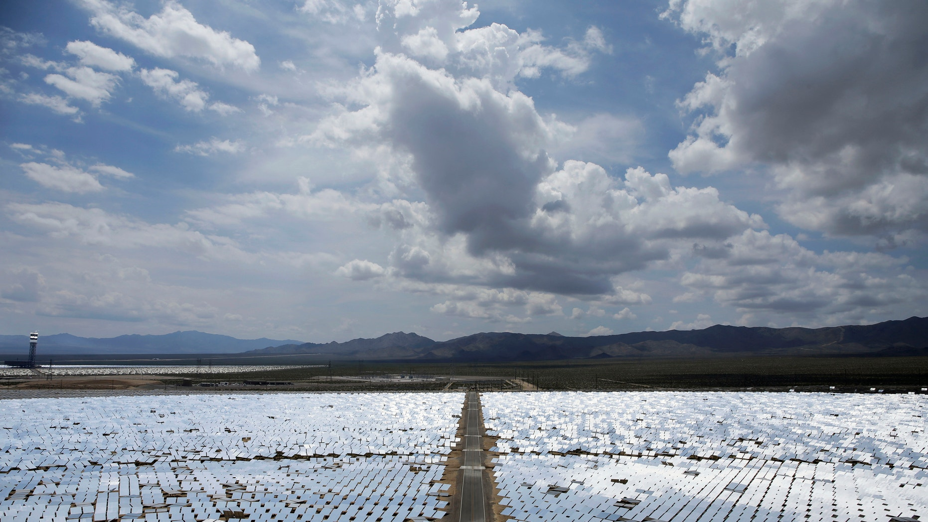 FILE -- This Aug. 13, 2014 photo, shows an array of mirrors at the Ivanpah Solar Electric Generating site in Primm, Nev.