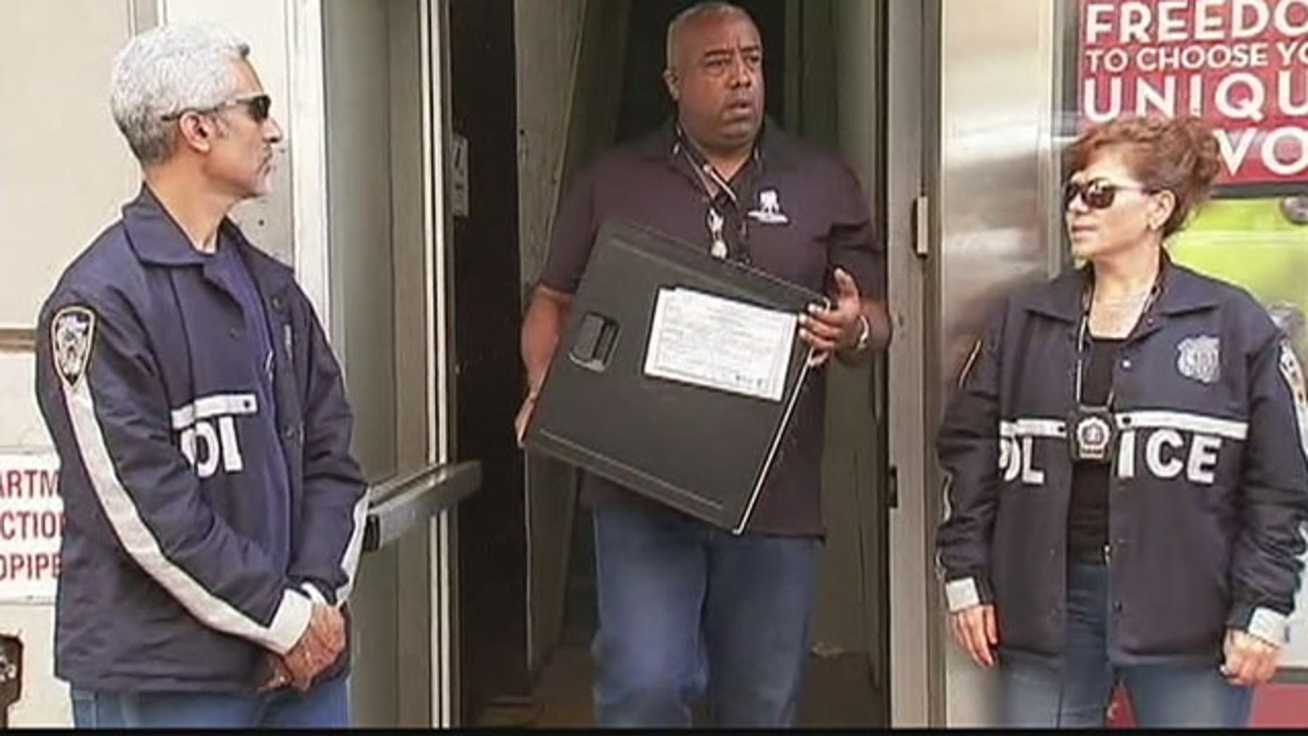 Aug. 25, 2015: Investigators remove computer equipment from the offices of Rentboy.com in New York City. (WNYW)